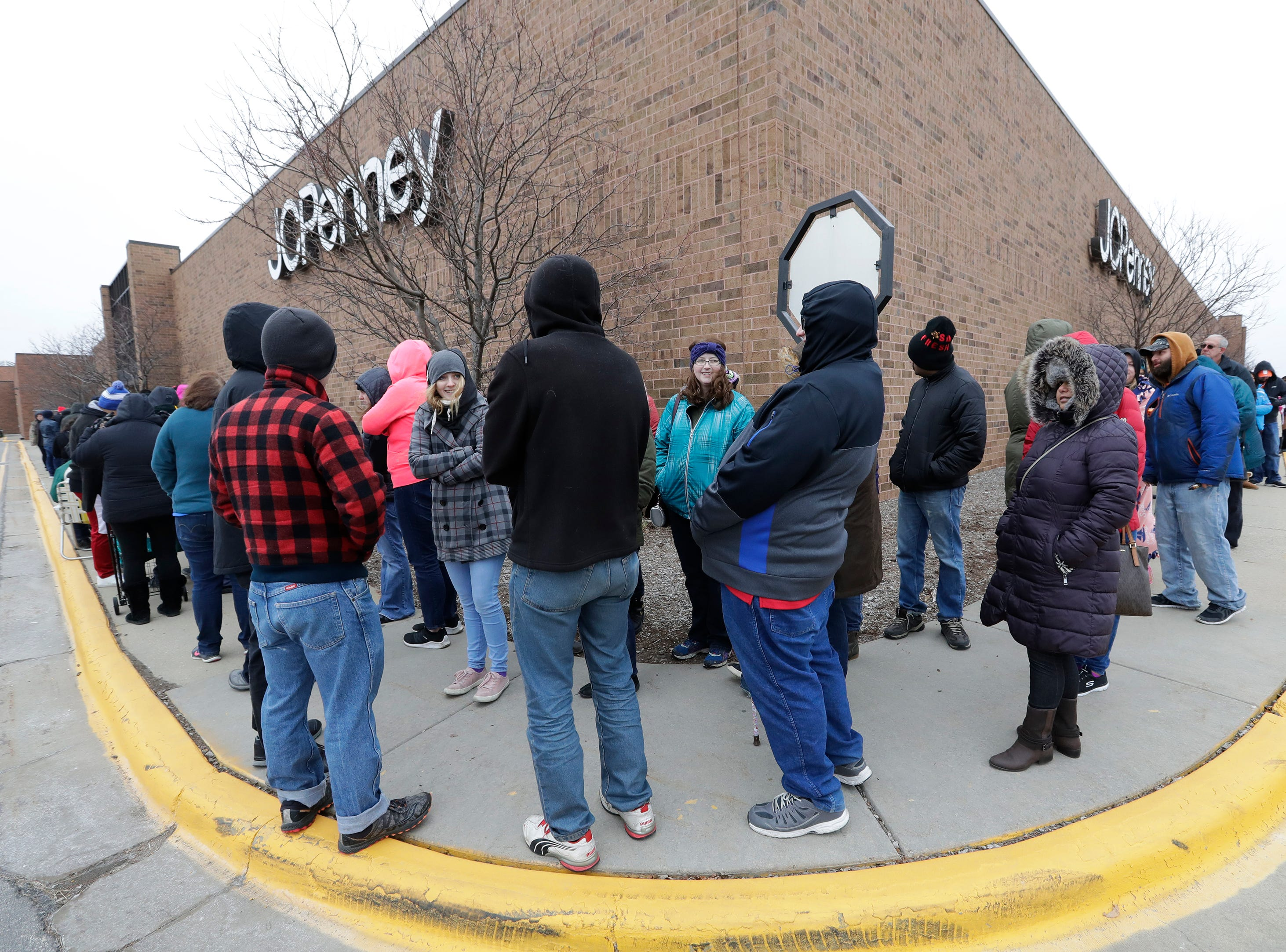 A long line of customers waits for Black Friday deals in front of JCPenney Thursday, November 22, 2018, in Grand Chute, Wis. 