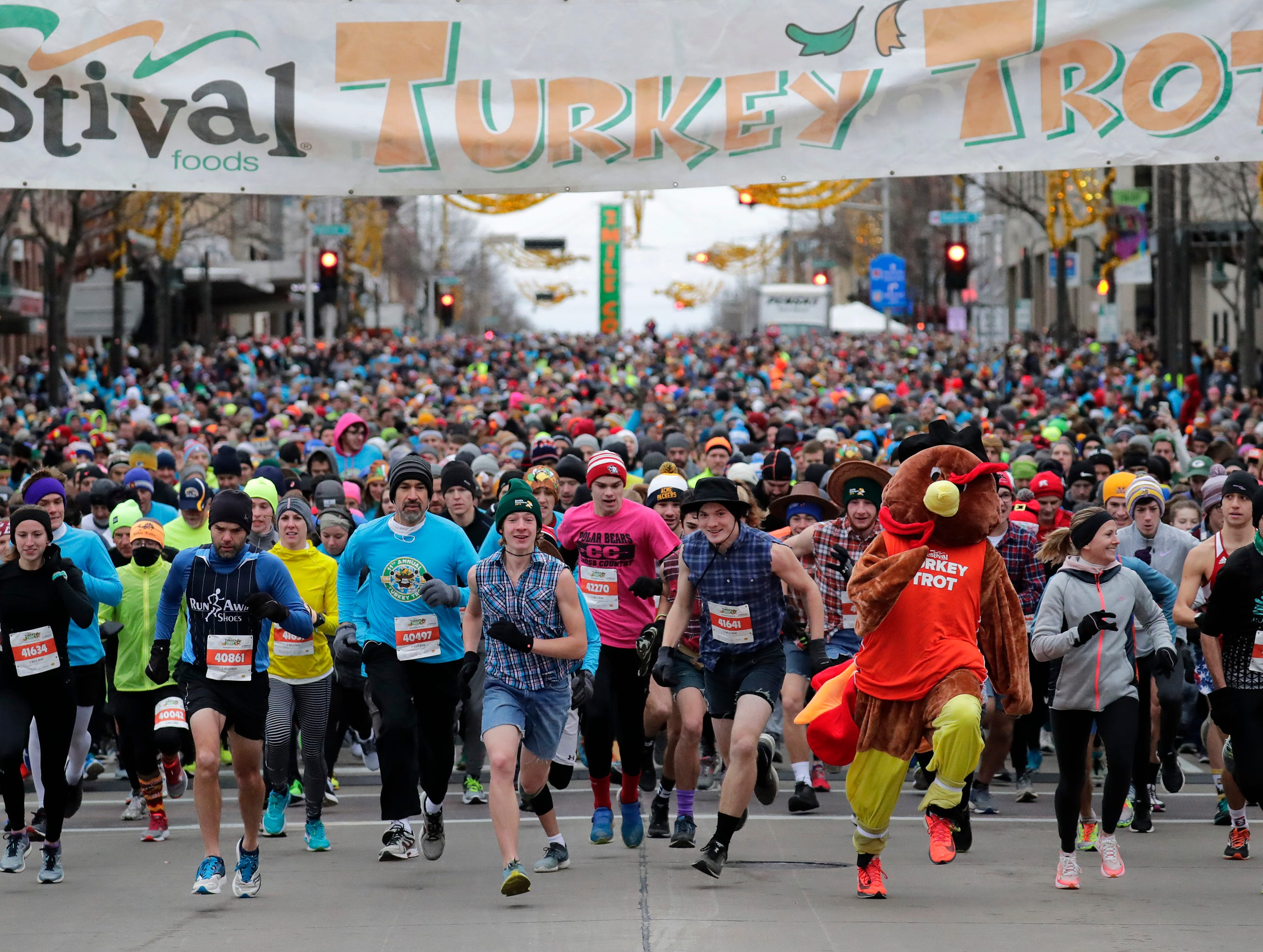 Participants take off from the starting line of the 11th Annual Festival Foods Turkey Trot Thursday, November 22, 2018, in Appleton, Wis. 
