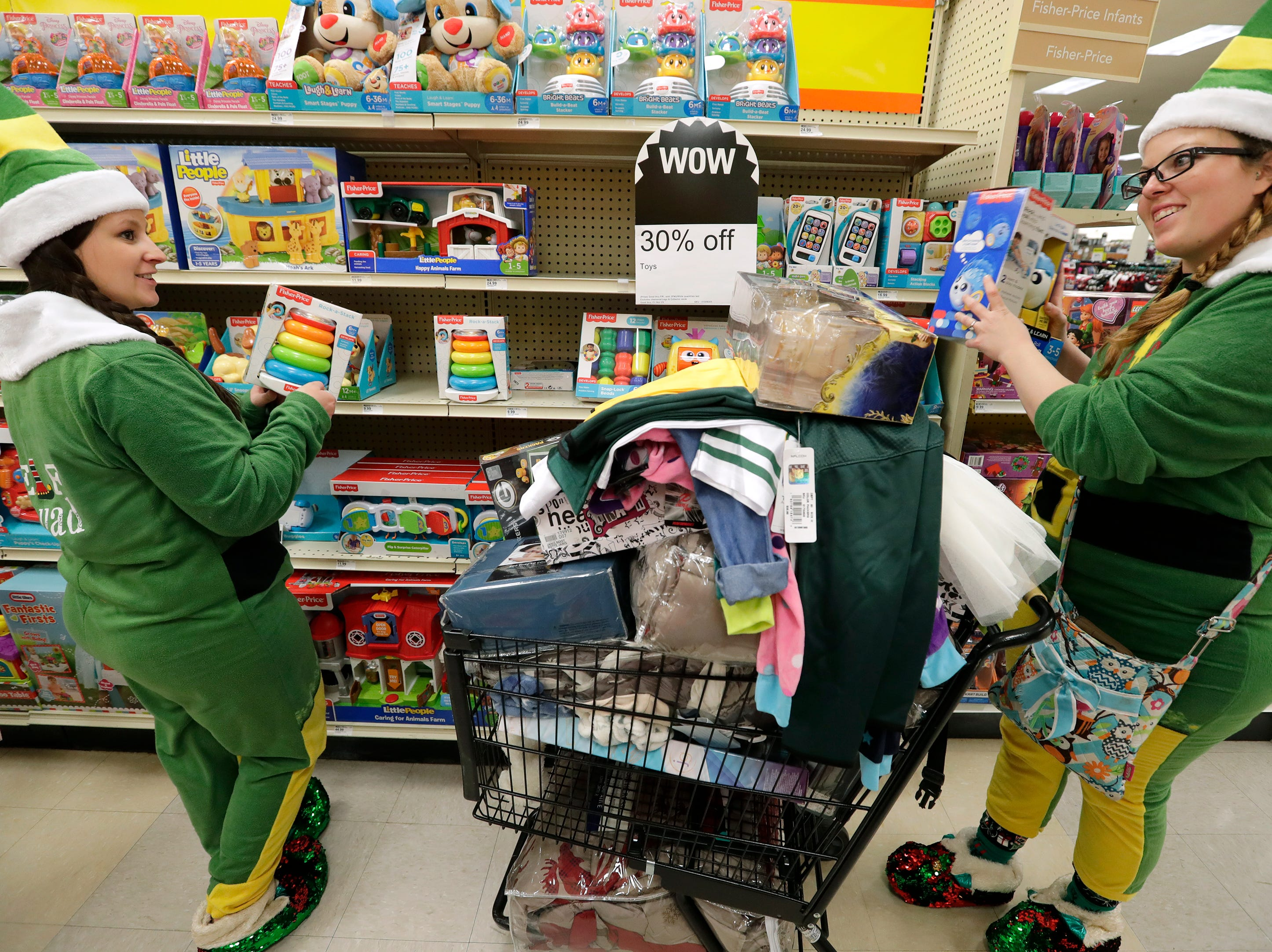 Dressed as elves, Morgan Dunbar, left, and Jennifer Hoagland shop for Black Friday deals at Shopko Thursday, November 22, 2018, in Appleton, Wis. 