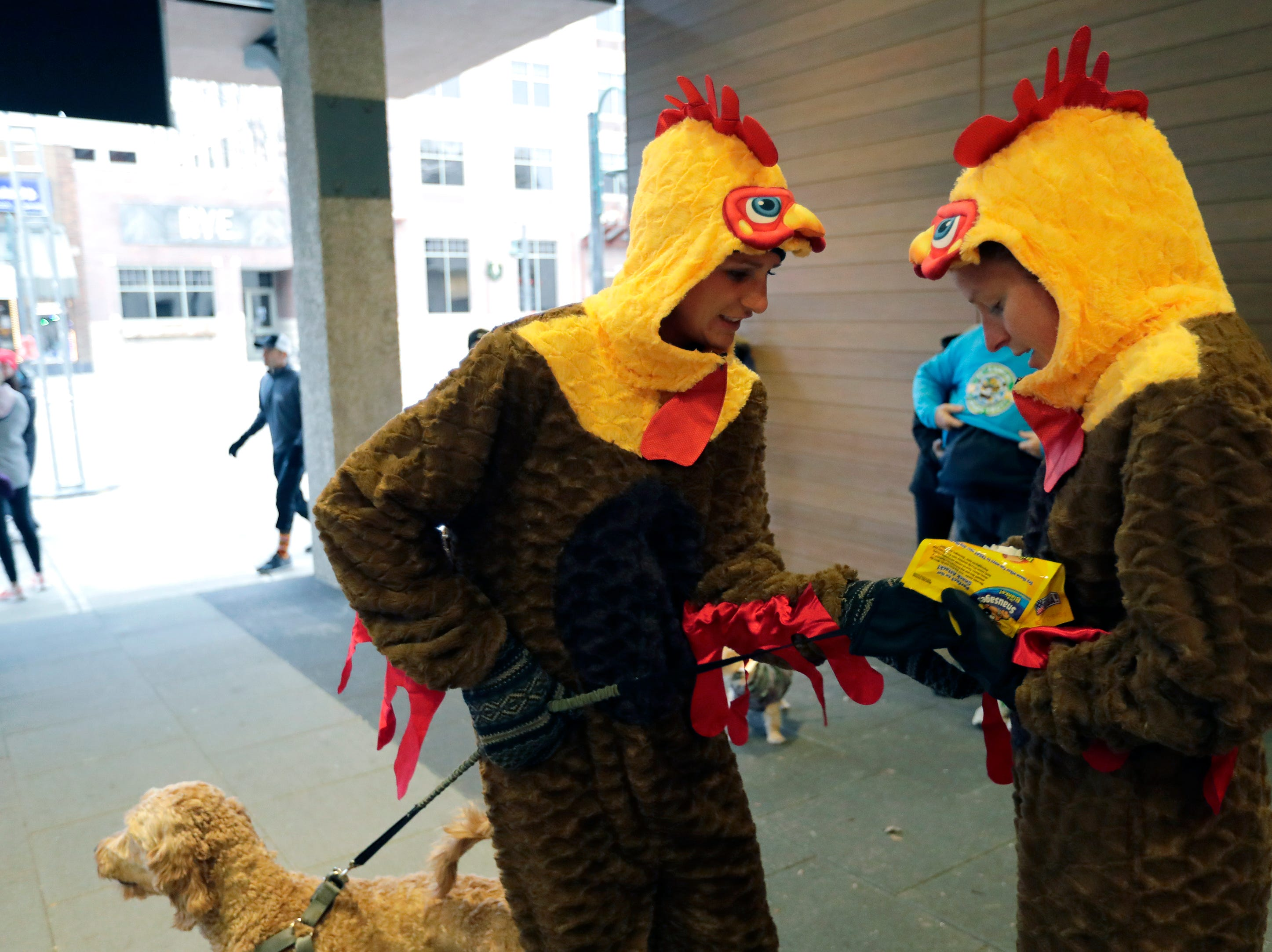 Ashley Schulke , left, of Hortonville and her sister Andrea Flease of Winneconne don turkey outfits during the 11th Annual Festival Foods Turkey Trot Thursday, November 22, 2018, in Appleton, Wis. 