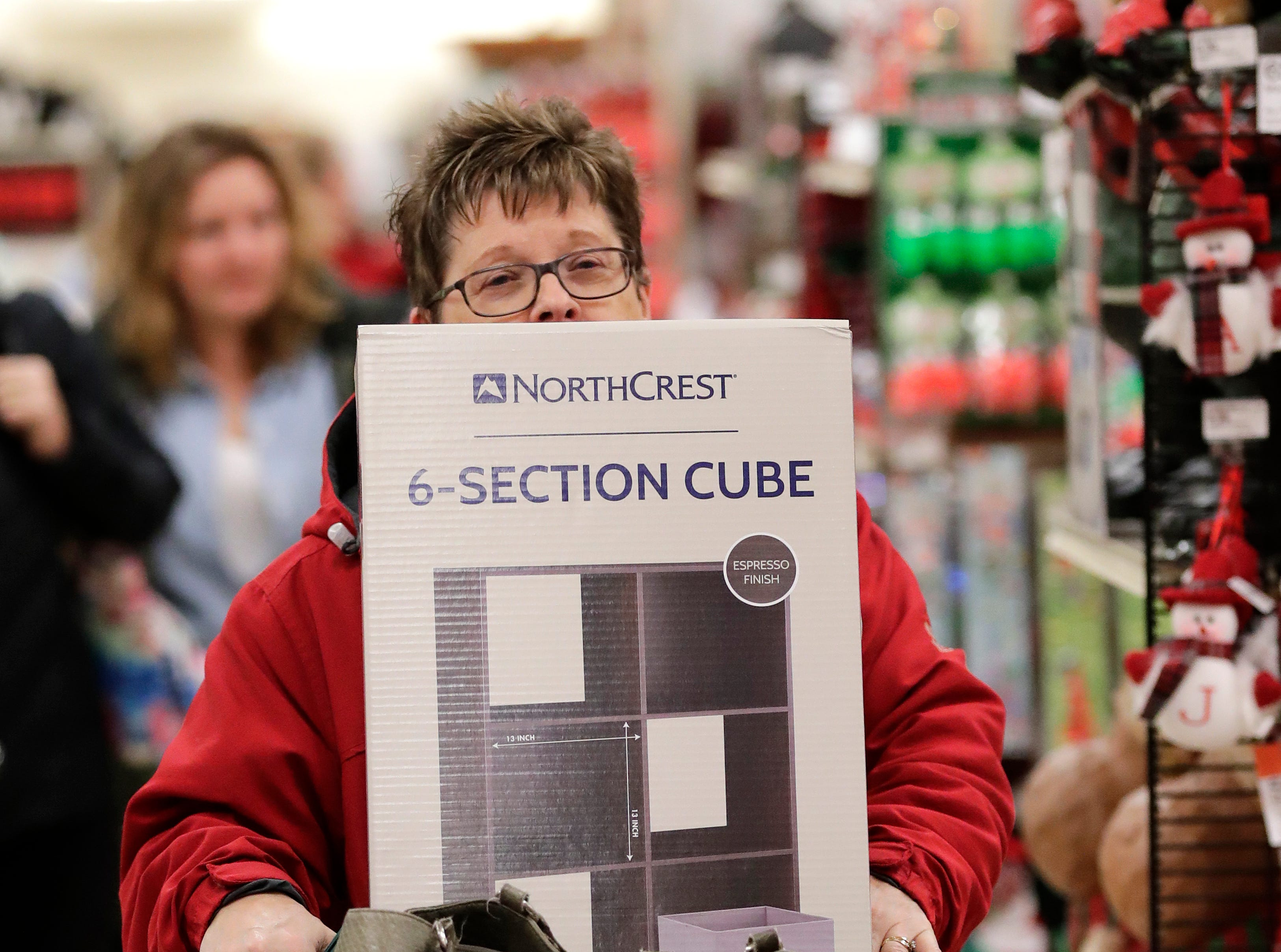 Karen Waehler of Hilbert has Black Friday deals stacked high in her cart while shopping at Shopko Thursday, November 22, 2018, in Appleton, Wis. 