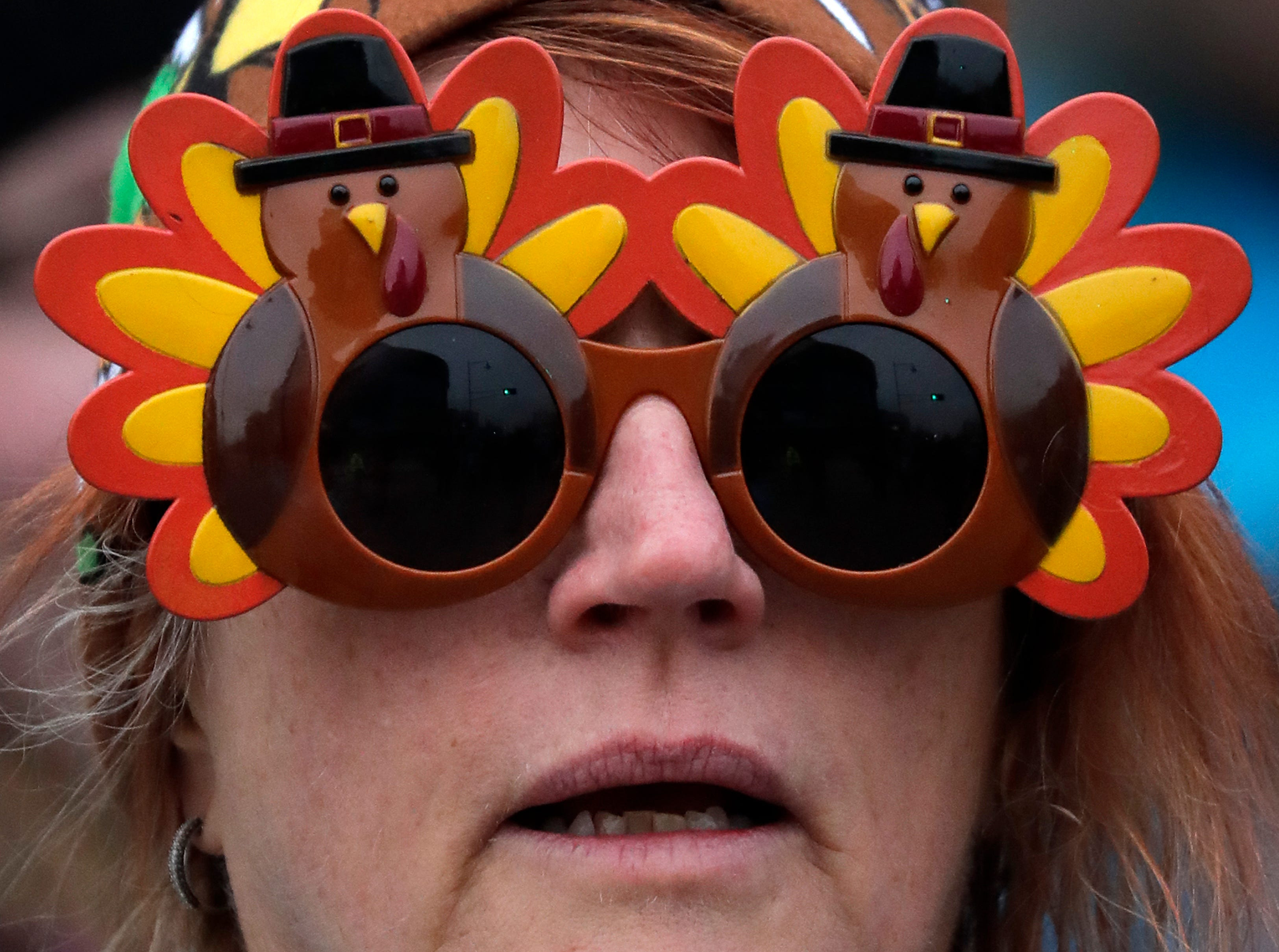 A participant dons turkey sunglasses during the 11th Annual Festival Foods Turkey Trot Thursday, November 22, 2018, in Appleton, Wis. 