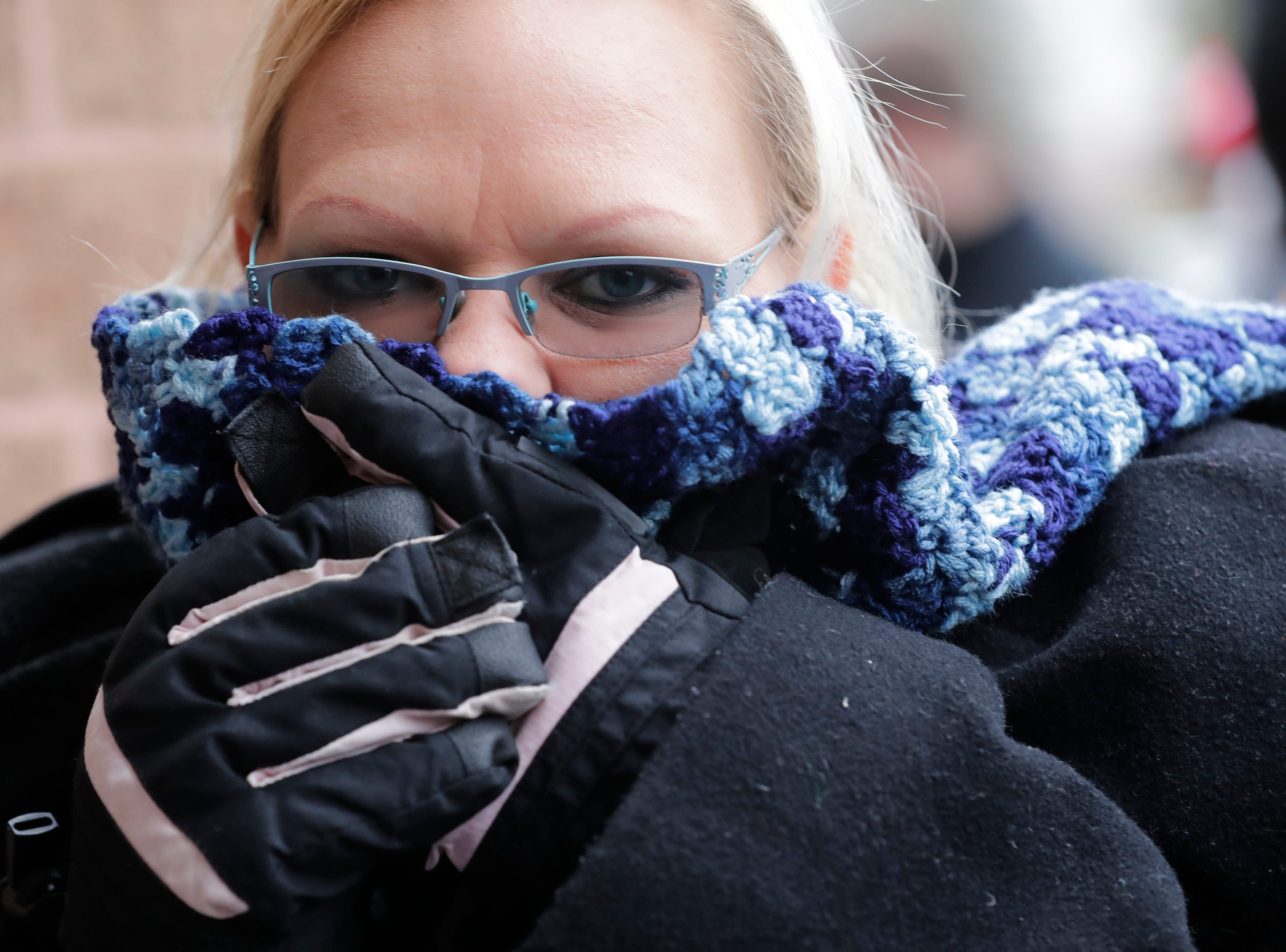 Cindy Kronberg of Kaukauna tries to stay warm while waiting in line outside for Black Friday deals at JCPenney Thursday, November 22, 2018, in Grand Chute, Wis. 
