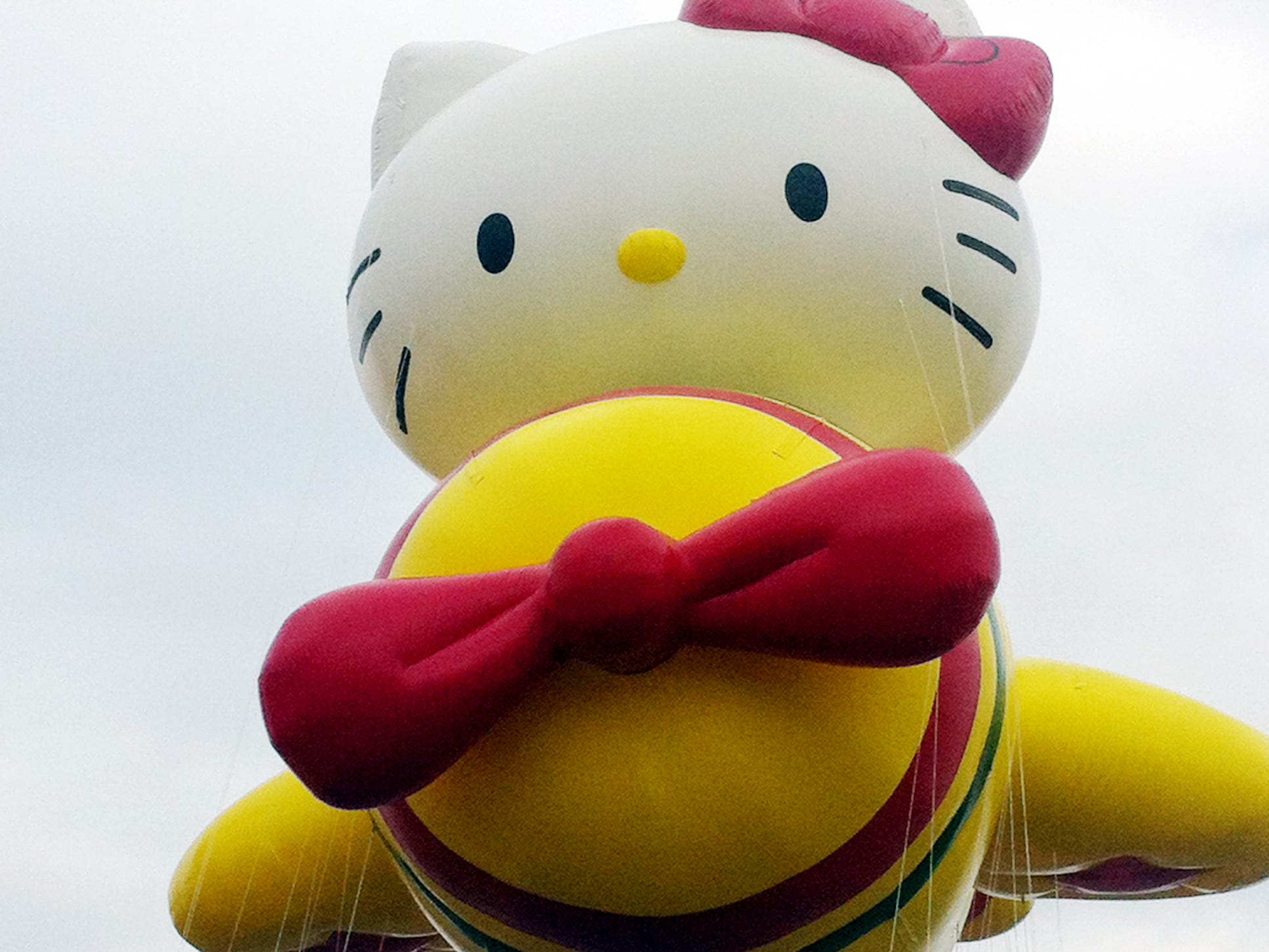 """The Hello Kitty balloon floats over the Meadowland?s race track during a Nov. 10 test flight in East Rutherford, N.J. Hello Kitty is one of three new balloons to be featured in the 2012 Macy?s Thanksgiving Parade. Macy?s/AP FILE - In this Nov. 10, 2012 file photo provided by Macy's, the """"Hello Kitty"""" balloon floats over the Meadowland's race track during a test flight in East Rutherford, N.J. """"Hello Kitty"""" is one of three new balloons to be featured in the 2012 Macy's Thanksgiving Parade. (AP Photo/Macy's, Inc.)"""