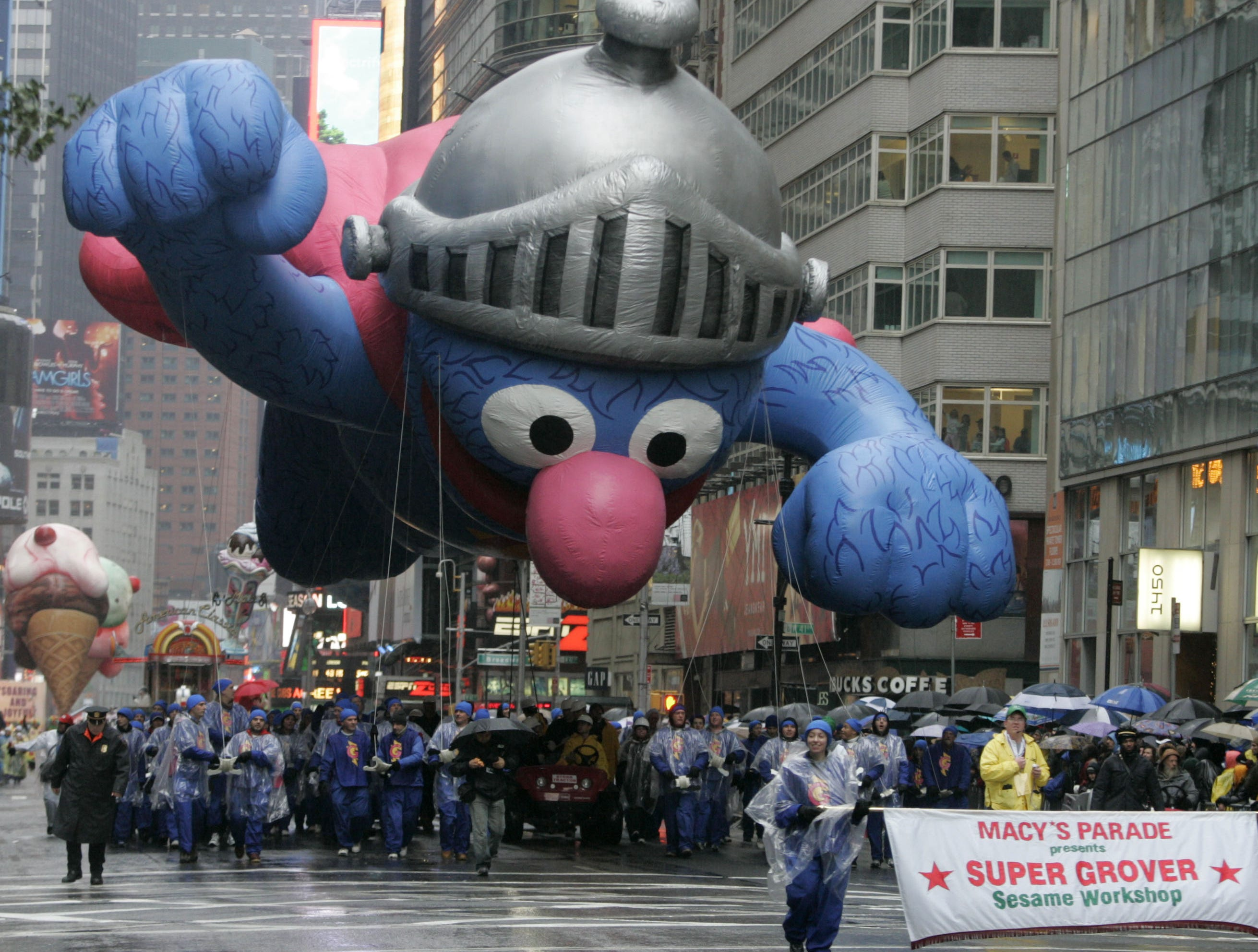 The Super Grover balloon moves down Seventh Ave. during the Macy's Thanksgiving Day parade Thursday, Nov. 23, 2006 in New York. Officials waited until right before the 9 a.m. start to decide whether it was safe for the event's famous balloons to float through Midtown. (AP Photo/Frank Franklin II)