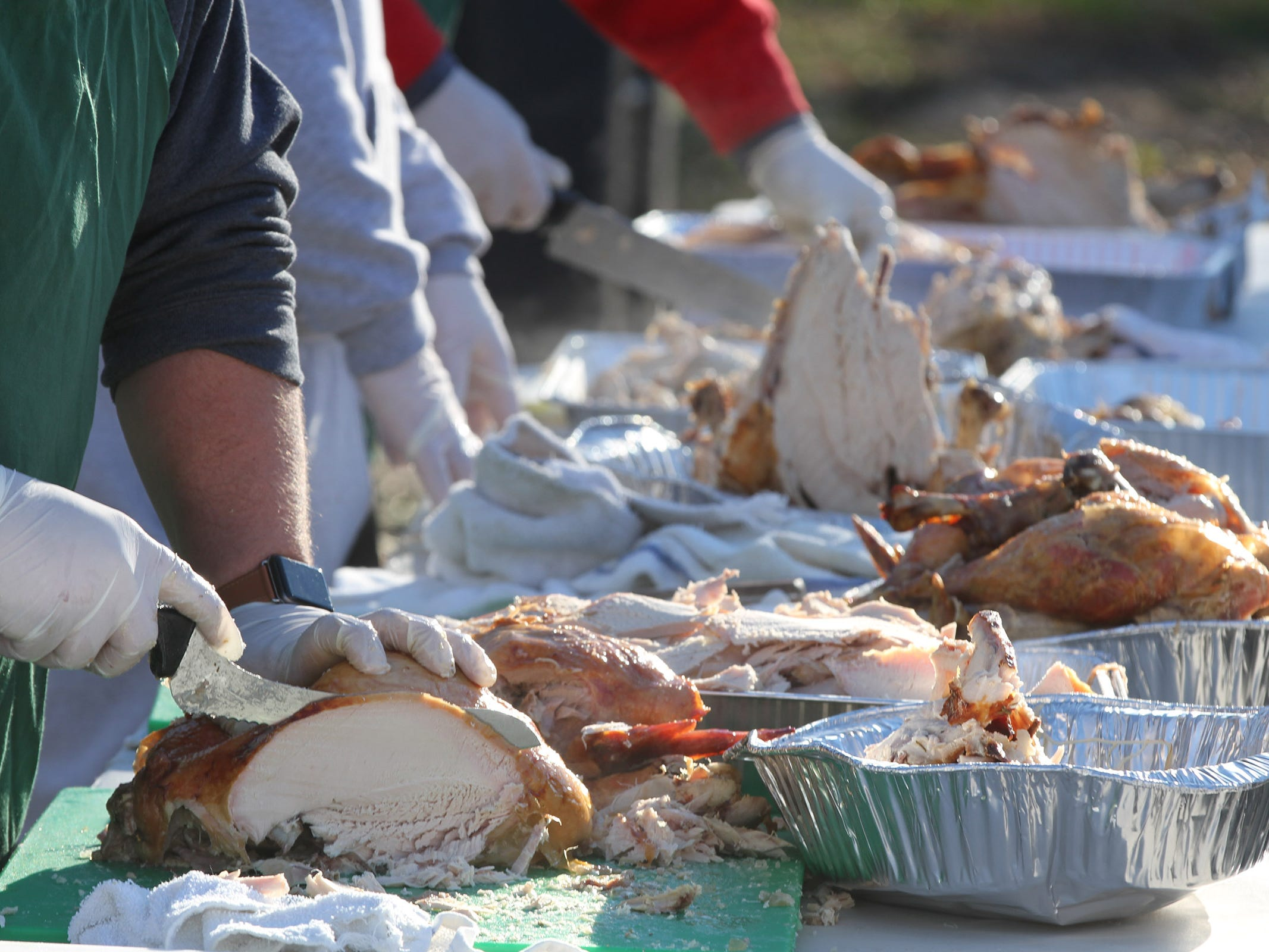 Turkeys are sliced at The Church of the Epiphany in Brick as they prepare and deliver meals to over 1,200 people in Monmouth and Ocean counties on Thanksgiving Day, November 22, 2018.