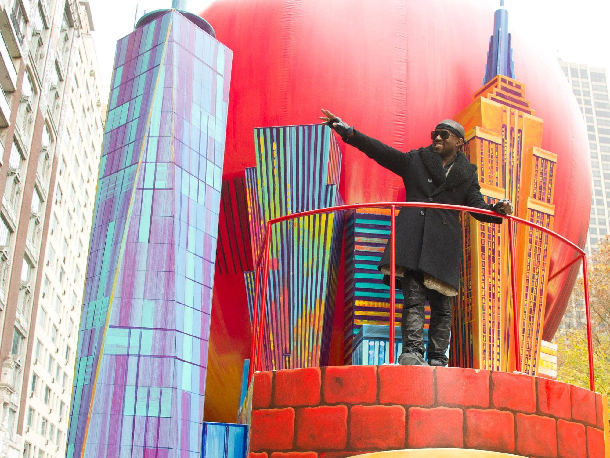 Kanye West rides a float down 7th Avenue in the Macy's Thanksgiving Day Parade in New York on Thursday, Nov. 25, 2010. (AP Photo/Charles Sykes)