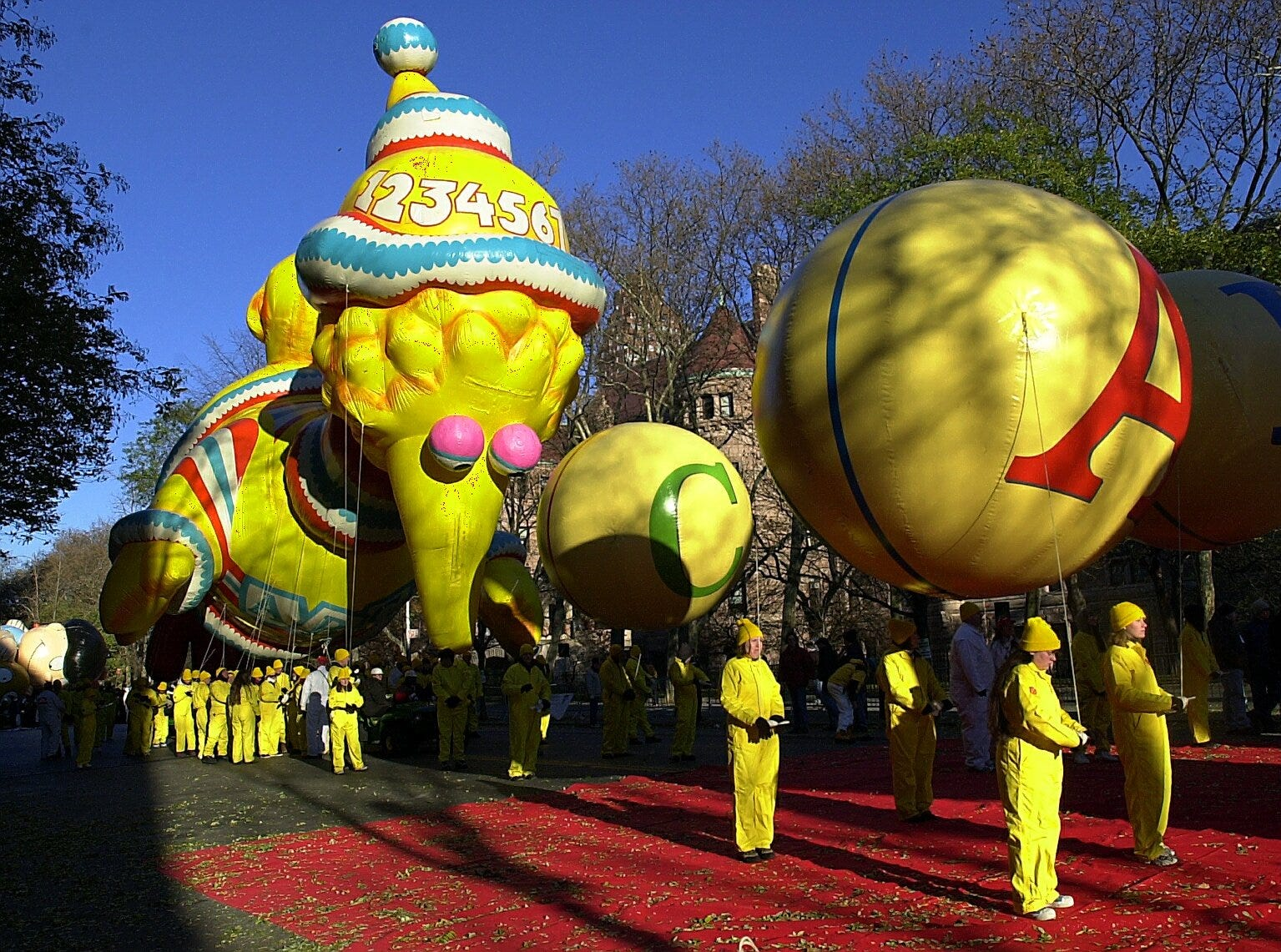 -  -Big Bird waits for his chance to float down the street at the Macy's Thanksgiving Day Parade Thursday. (Carmen Troesser / The Journal News 11/23/00)