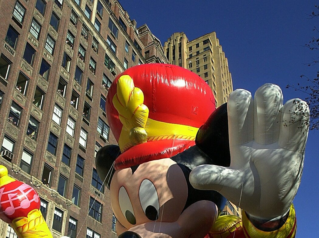 -  -Mickey Mouse follows closely behind the Macy's turkey down Central Park West at the Macy's Thanksgiving Day Parade Thursday. (Carmen Troesser / The Journal News 11/23/00)