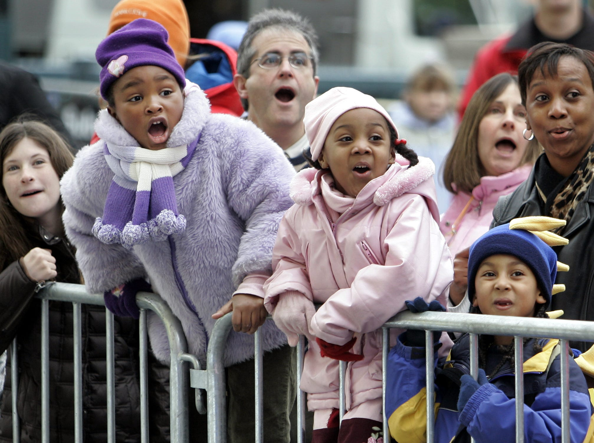 From left, Bianca Black, 6, Alicia Smith, 5, and Kevin Singleton, 5, all from New York City, watch as the Energizer Bunny is filled by  volunteer members of the Macy's inflation team on 81st street in New York City Nov. 22, 2006. (Stephen Schmitt / The Journal News)