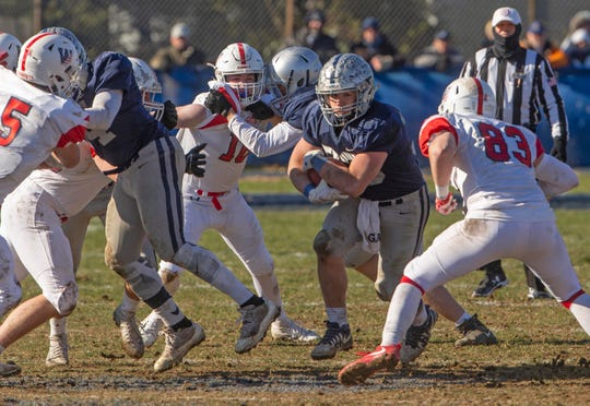 Manasquan's Canyon Birch carries ball up the middle during second half action. Wall football vs Manasquan in Thanksgiving game in Mansquan, NJ on  November 22, 2018.