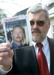 Dan Mahony, chief of Ocean County Investigators, holds a photo of Edward L. Lutes Jr. who was wanted in a 2002 series of murders until he turned up dead of apparent suicide.