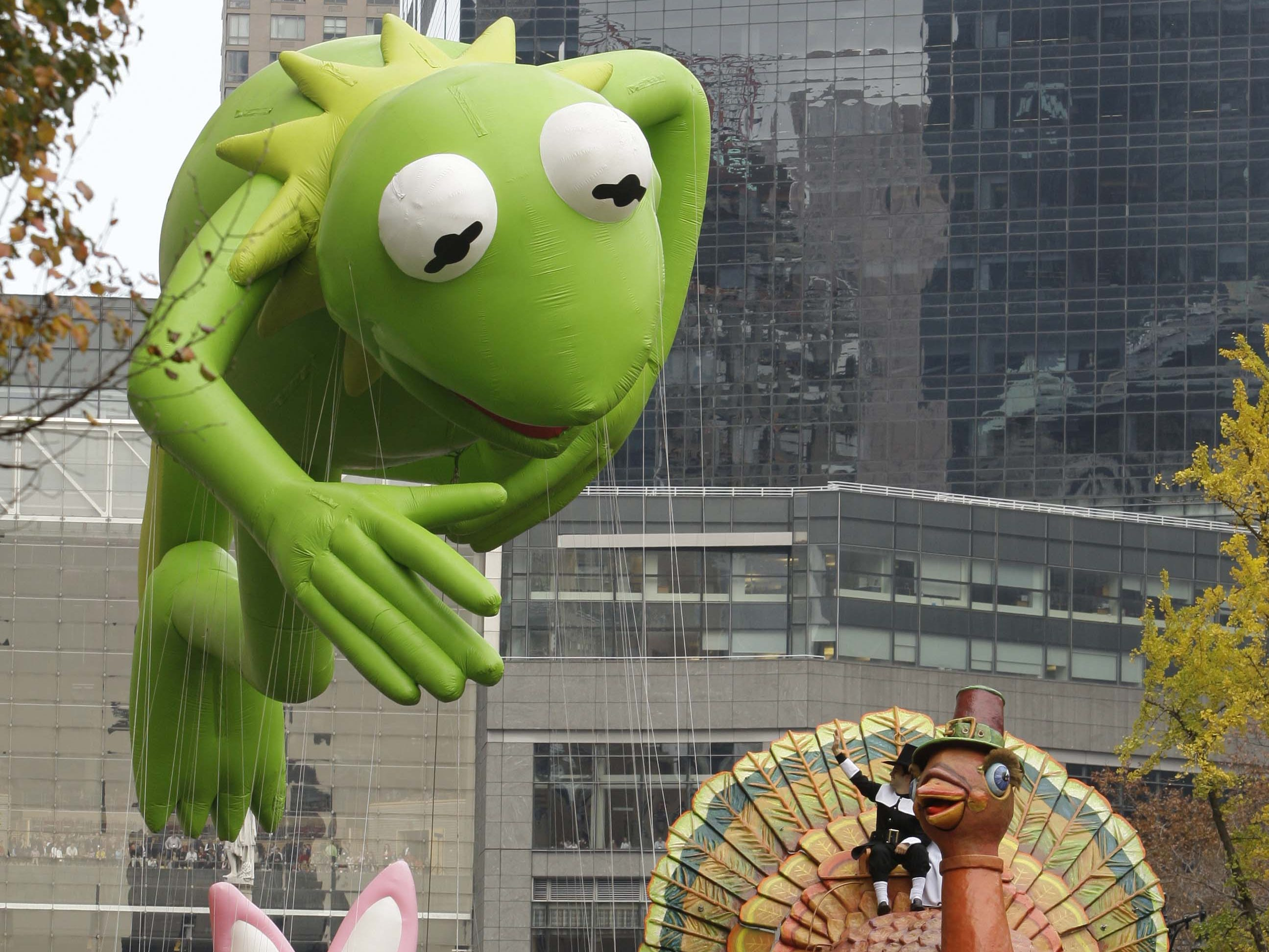 The Kermit the Frog and the Energizer Bunny floats are guided across Central Park South during the Macy's Thanksgiving Day Parade Thursday, Nov. 26, 2009 in New York. (AP Photo/Frank Franklin II)