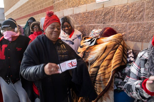 Shoppers brave the cold outside Target at the Seaview Square Mall for the store to open at 5pm on Thanksgiving in search of Black Friday bargains.