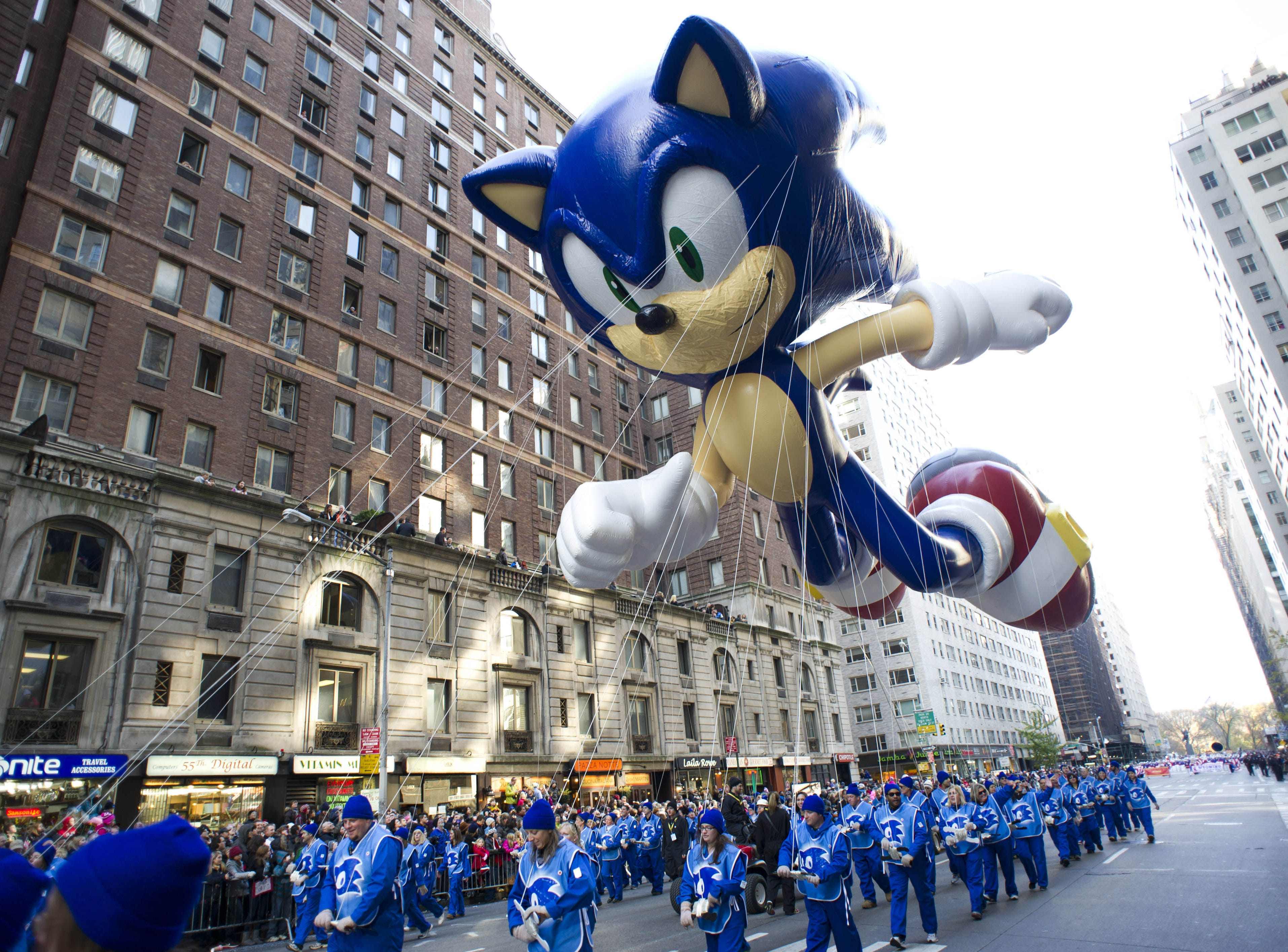 Macy?s will not allow giant balloons to fly during the parade if wind gusts are too strong. AP FILE - In this Nov. 22, 2012, file photo, handlers keep a tight rein on the Sonic the Hedgehog balloon as it travels the route of the Macy's Thanksgiving Day Parade in New York. (AP Photo/Charles Sykes, File)