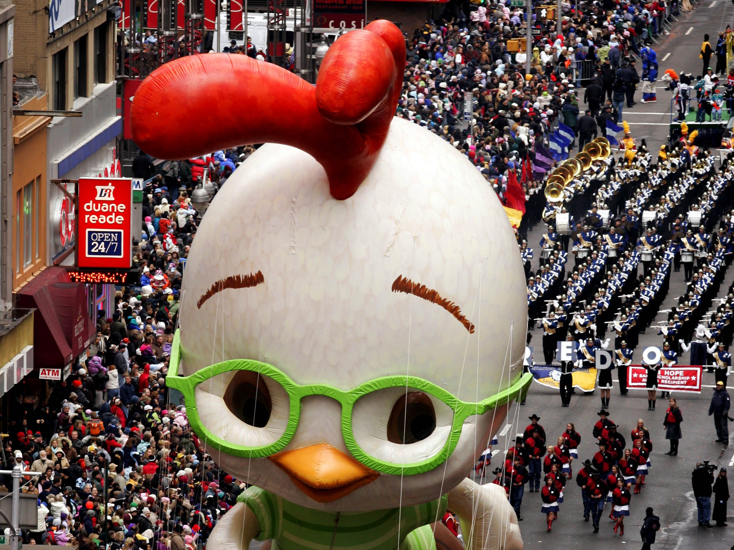 """11/25/2005, 6C:   The """"Chicken Little""""  balloon floats down Broadway during the Macy's Thanksgiving Day parade in New York, Thursday, Nov. 24, 2005.     (AP Photo/Jeff Christensen)"""