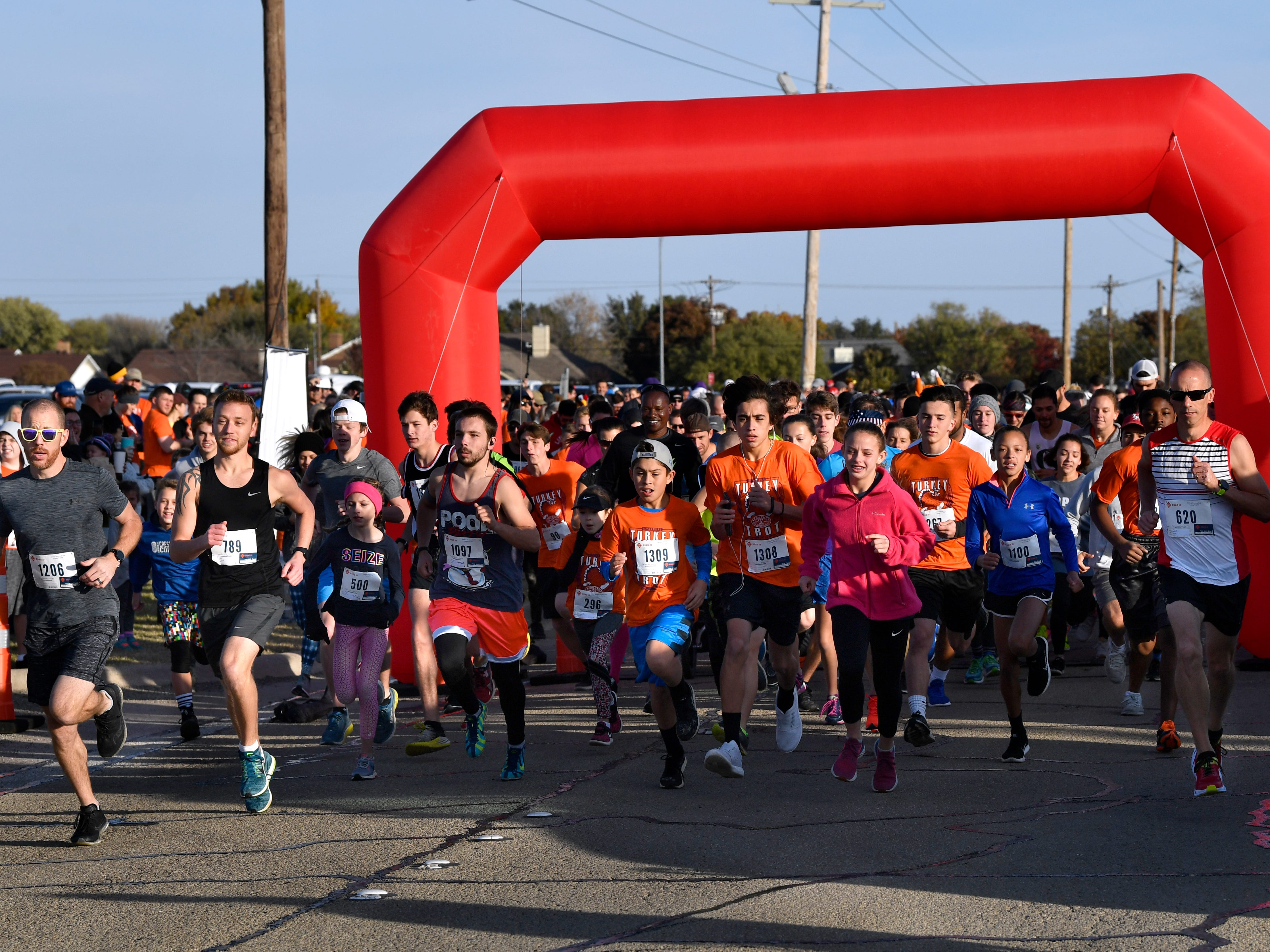 "Runners begin the annual Abilene Turkey Trot Thursday Nov. 22, 2018. Sponsored by the Abilene Runners Club, the Thanksgiving 5K course started at Shotwell Stadium, went through the adjacent Lytle neighborhood, then finished back at Shotwell. Proceeds benefited the West Texas Rehab Center and the Abilene Runners Club; their motto for the day was, ""Walk/run 3.1 miles and eat guilt free the rest of the day!"""