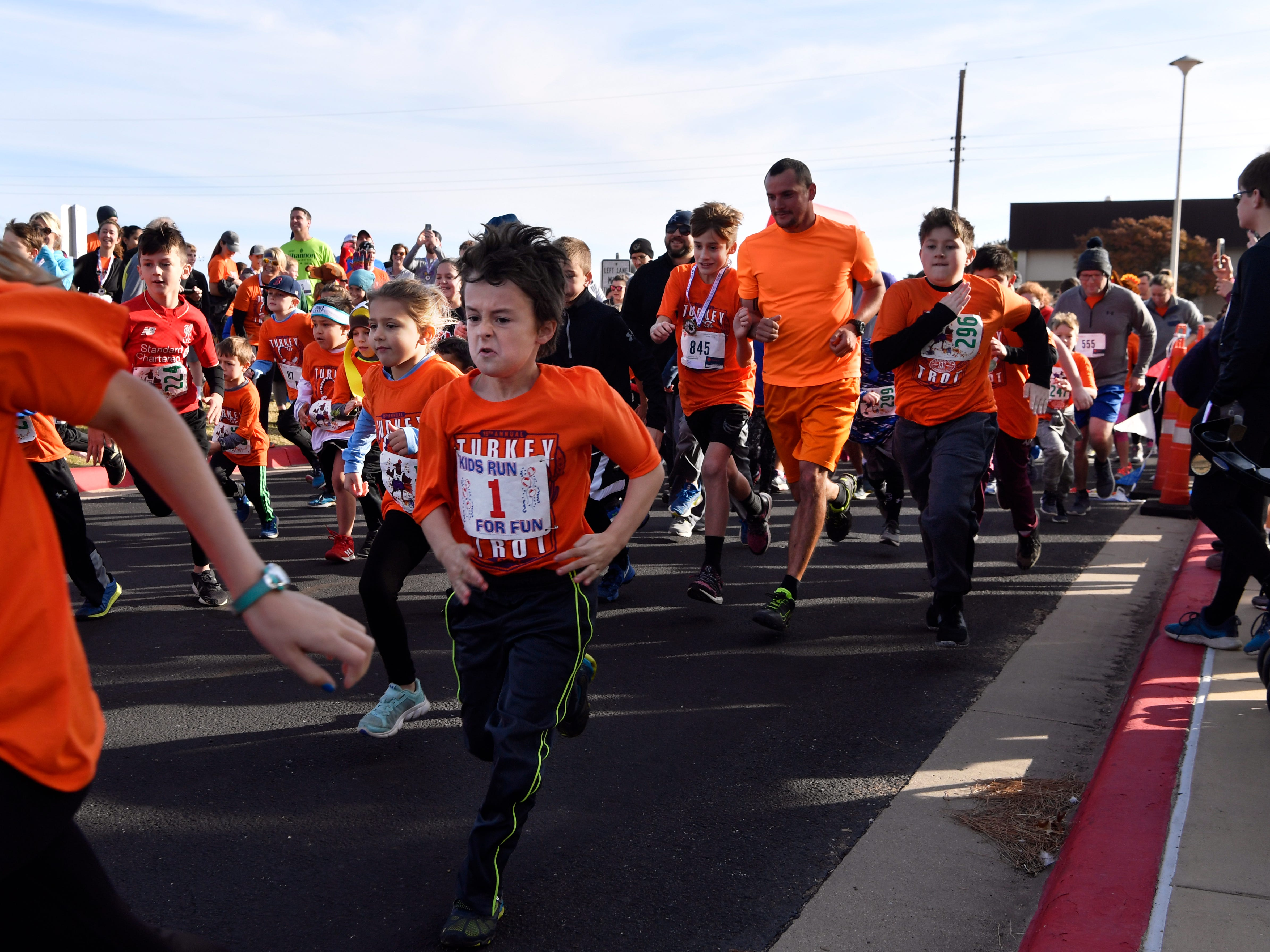 "Children begin the one-mile fun-run during the Abilene Turkey Trot Thursday Nov. 22, 2018. The course was twice around Shotwell Stadium. Sponsored by the Abilene Runners Club, the larger Thanksgiving 5K course started at Shotwell, went through the adjacent Lytle neighborhood, then finished back at the stadium. Proceeds benefited the West Texas Rehab Center and the Abilene Runners Club; their motto for the day was, ""Walk/run 3.1 miles and eat guilt free the rest of the day!"""