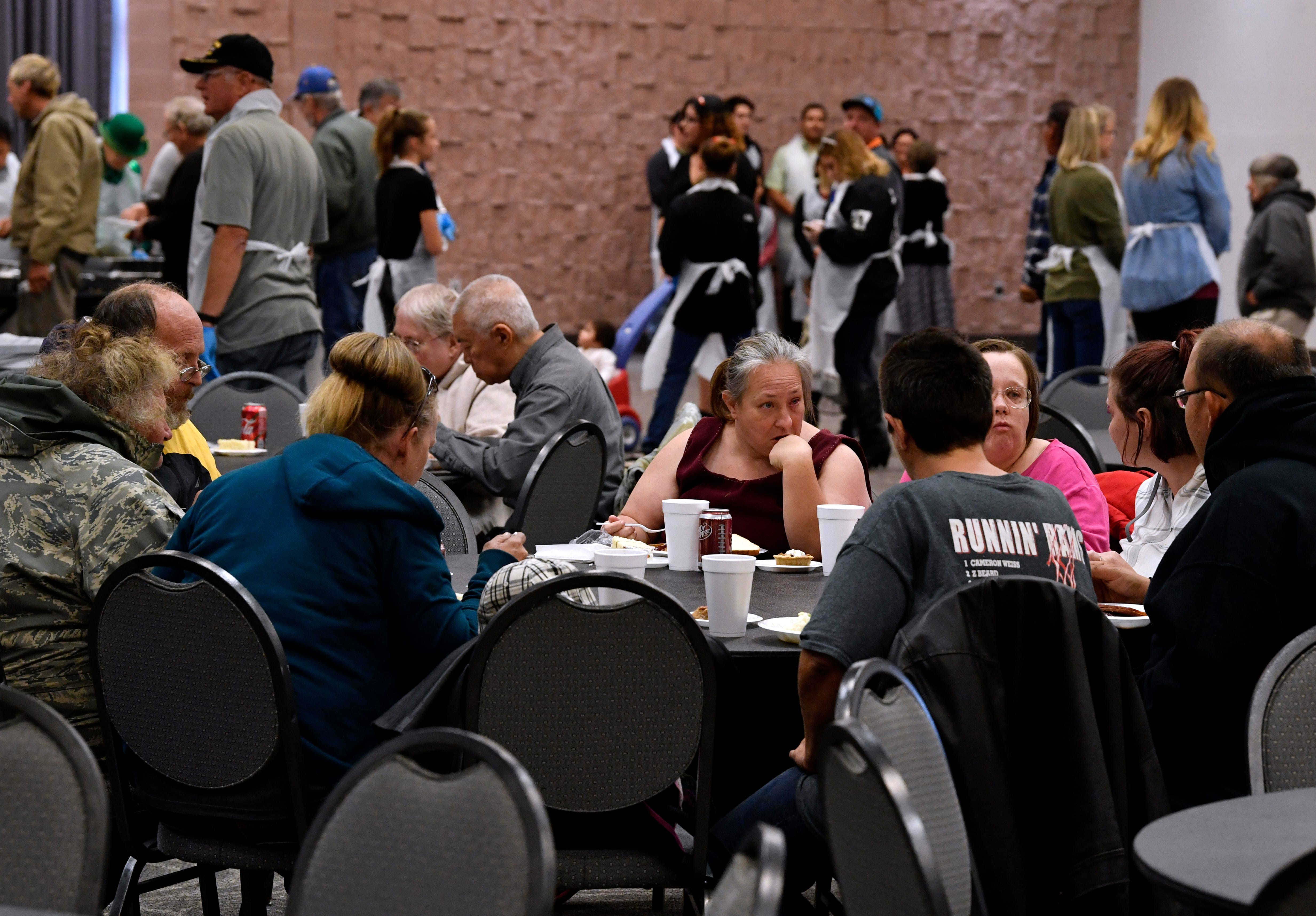 Diners eat and wait in line during Operation Thanksgiving Thursday at the Abilene Convention Center. The annual free holiday meal is sponsored by the Taylor County Veterans Service Office.