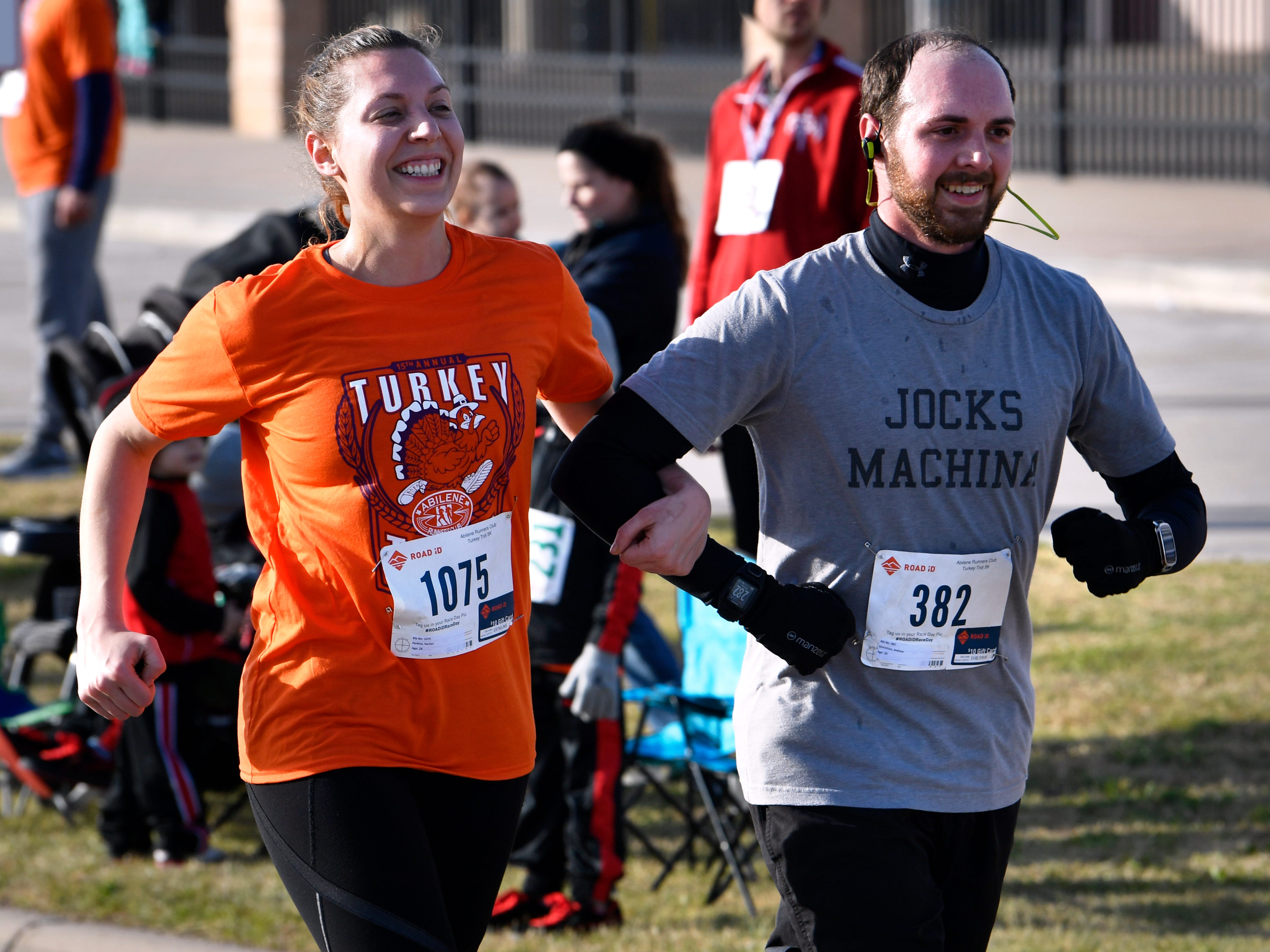 "A couple finishes the Abilene Turkey Trot 5K arm-in-arm Thursday Nov. 22, 2018. Sponsored by the Abilene Runners Club, the Thanksgiving 5K course started at Shotwell Stadium, went through the adjacent Lytle neighborhood, then finished back at Shotwell. Proceeds benefited the West Texas Rehab Center and the Abilene Runners Club; their motto for the day was, ""Walk/run 3.1 miles and eat guilt free the rest of the day!"""