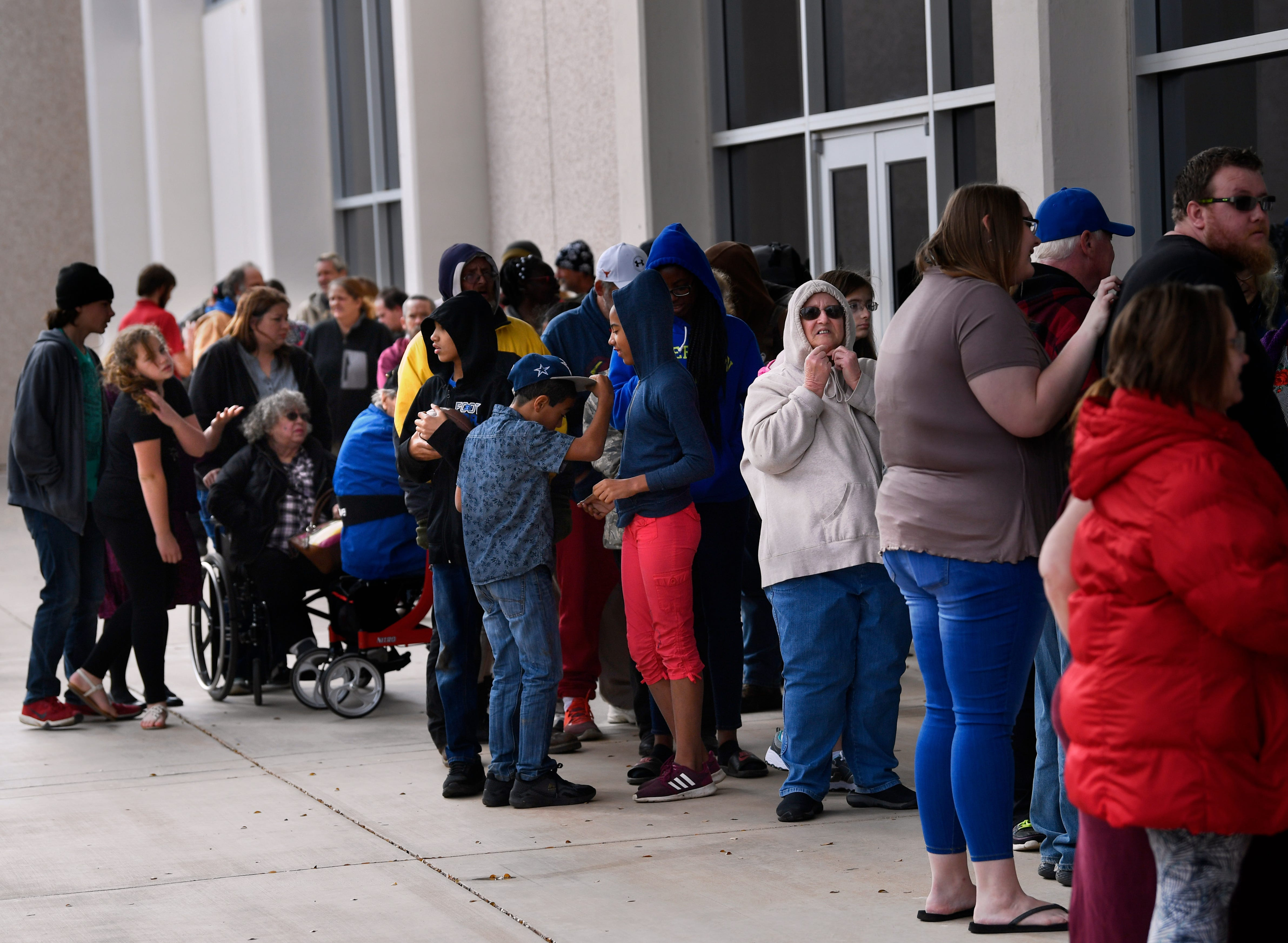 Diners line up at the Abilene Convention Center for Operation Thanksgiving Thursday.