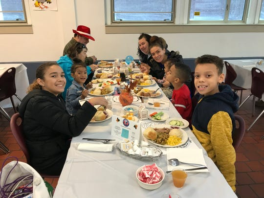Families enjoy Thanksgiving Dinner at Binghamton High School.