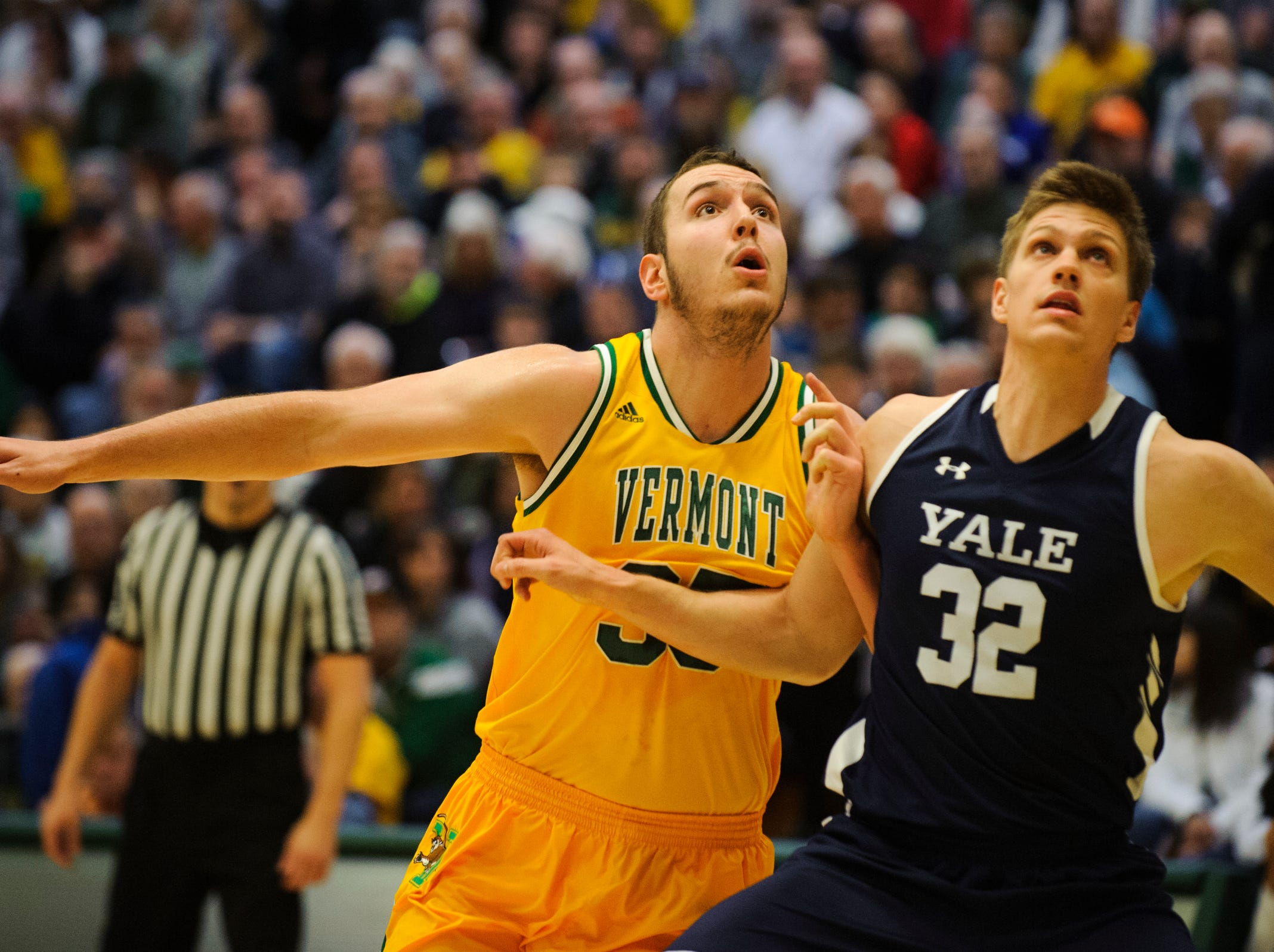 Vermont forward Ryan Davis (35) and Yale's Blake Reynolds (32) battle for position during a free throw attempt during the men's basketball game between the Yale Bulldogs and the Vermont Catamounts at Patrick Gym on Wednesday night November 21, 2018 in Burlington.