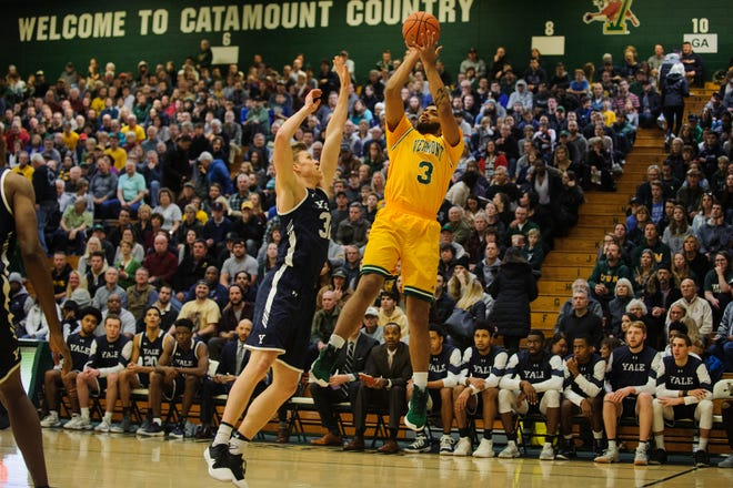Vermont forward Anthony Lamb (3) leaps to take a shot over Yale's Blake Reynolds (32) during the men's basketball game between the Yale Bulldogs and the Vermont Catamounts at Patrick Gym on Wednesday night November 21, 2018 in Burlington.