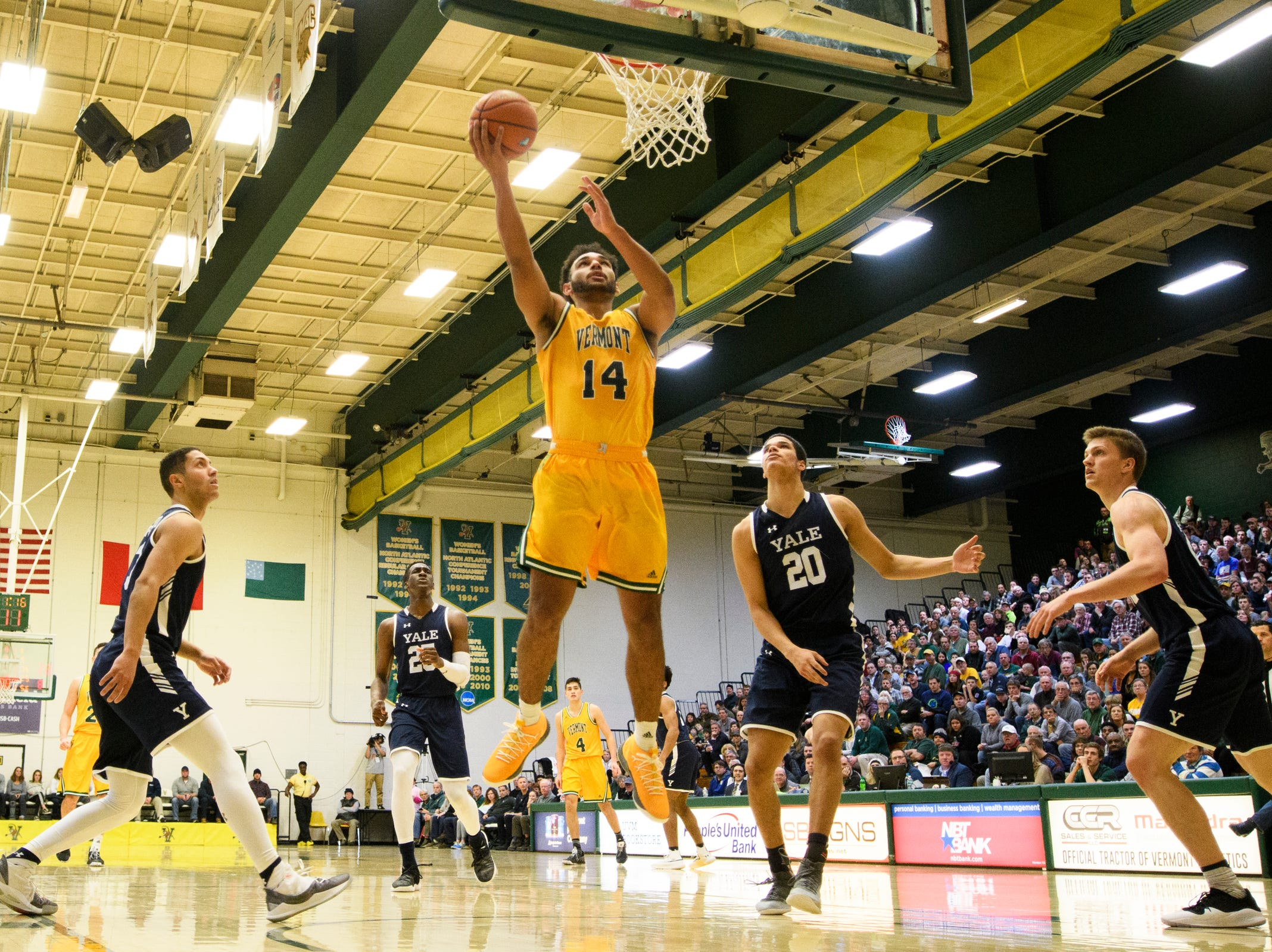 Vermont forward Isaiah Moll (14) leaps for a lay up during the men's basketball game between the Yale Bulldogs and the Vermont Catamounts at Patrick Gym on Wednesday night November 21, 2018 in Burlington.