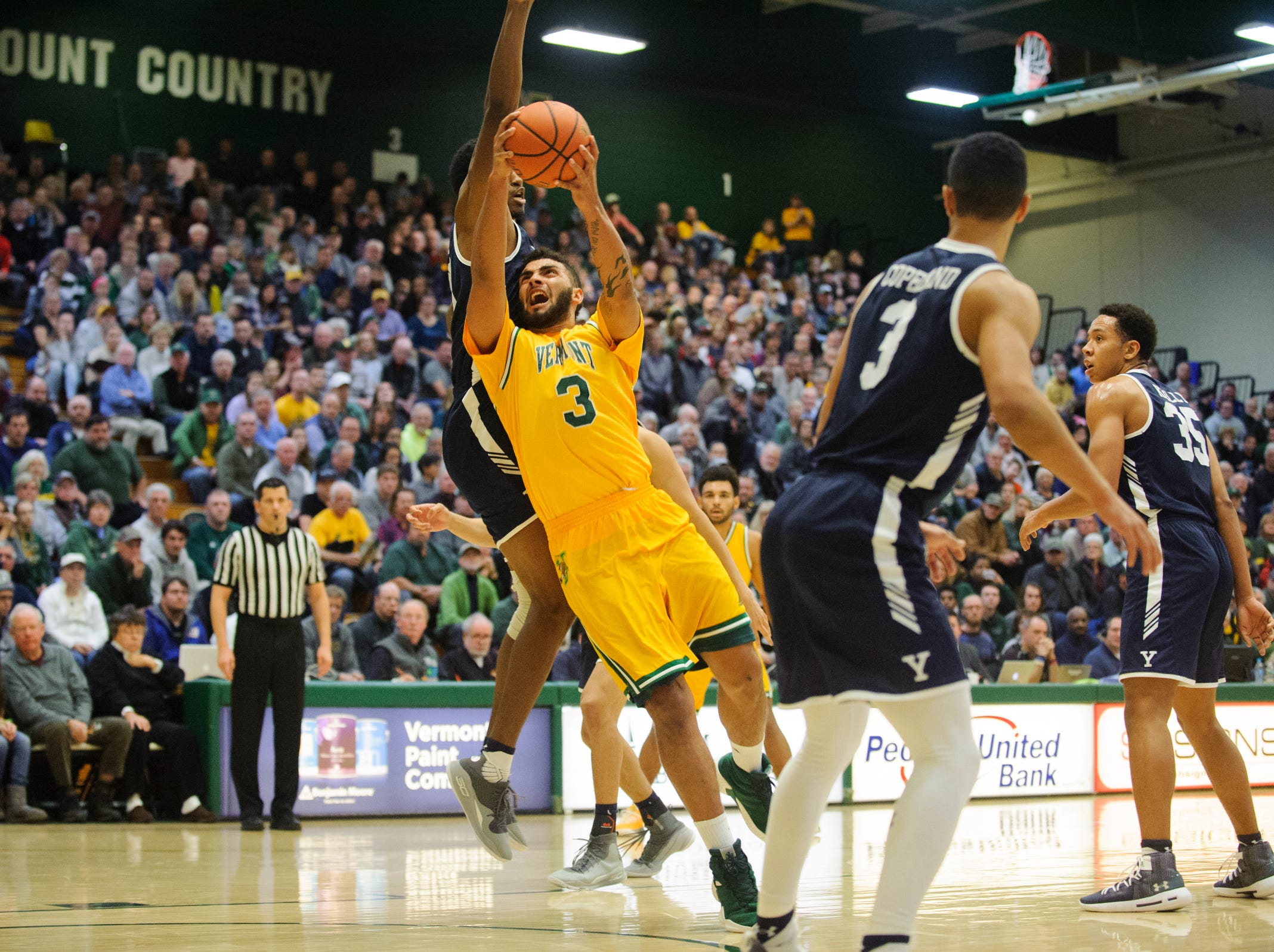 Vermont forward Anthony Lamb (3) drives to the hoop for a lay up during the men's basketball game between the Yale Bulldogs and the Vermont Catamounts at Patrick Gym on Wednesday night November 21, 2018 in Burlington.
