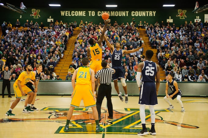 Vermont forward Ra Kpedi (15) and Yale's Jordan Bruner (25) battle for the opening tip off during the men's basketball game between the Yale Bulldogs and the Vermont Catamounts at Patrick Gym on Wednesday night November 21, 2018 in Burlington.