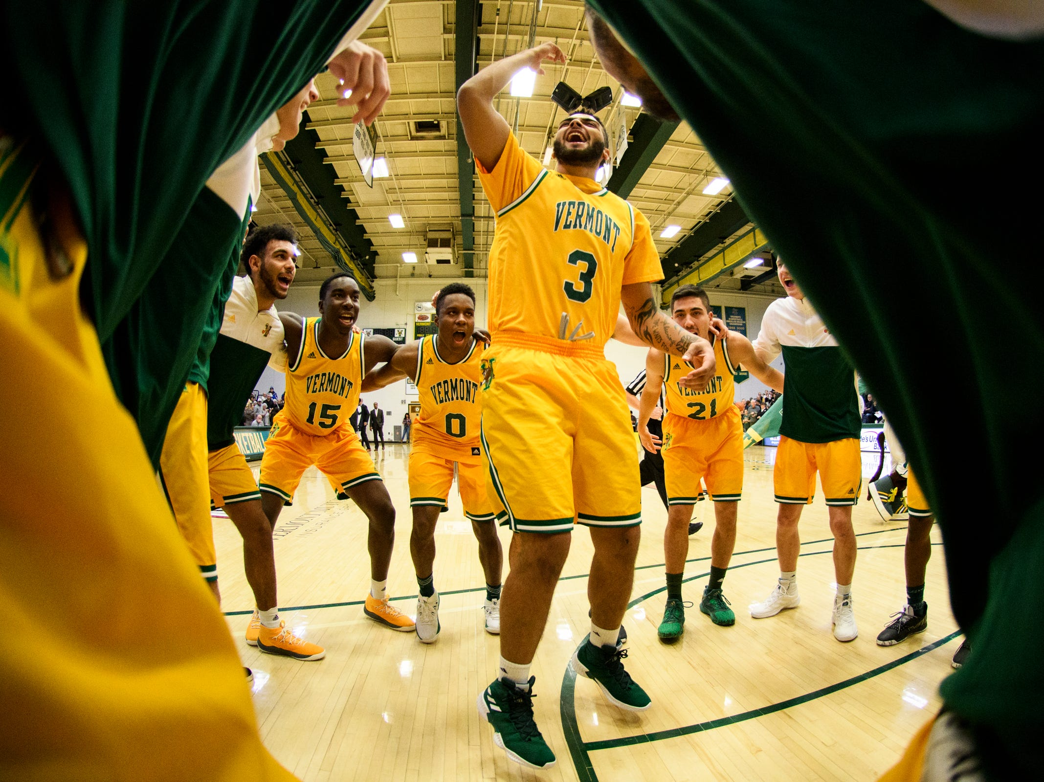 Vermont forward Anthony Lamb (3) pumps up the team in the huddle during the men's basketball game between the Yale Bulldogs and the Vermont Catamounts at Patrick Gym on Wednesday night November 21, 2018 in Burlington.