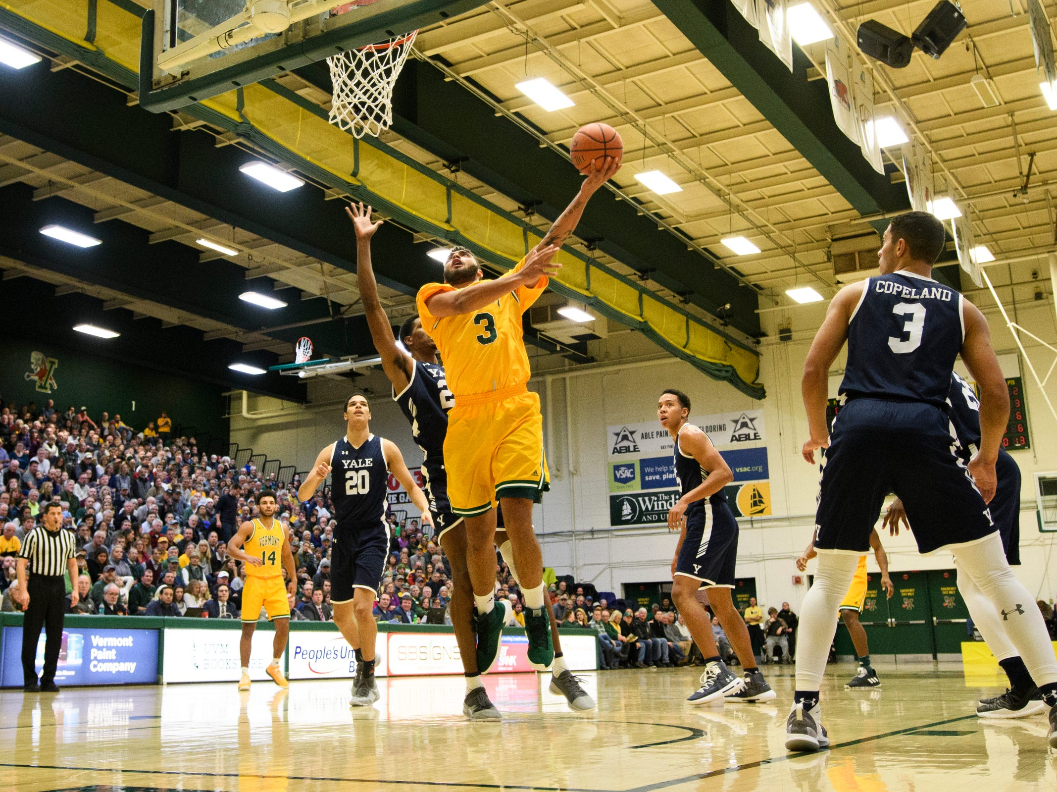 Vermont forward Anthony Lamb (3) leaps for a lay up during the men's basketball game between the Yale Bulldogs and the Vermont Catamounts at Patrick Gym on Wednesday night November 21, 2018 in Burlington.