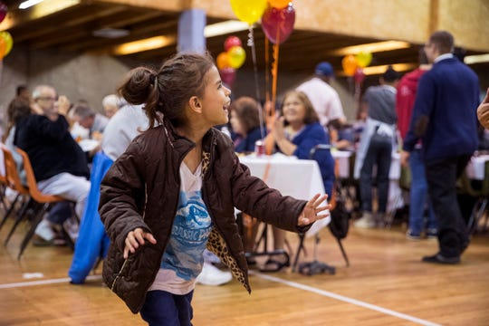 Jasmine Knight, 5, dances (left) during the 75th annual Joe Salem Dinner at Sokol Gym on Thanksgiving on Thursday, November 22, 2018.
