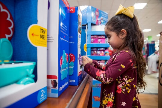 Allanna Hernandez, 4, plays while her family hunts for Christmas bargains at JCPenney in La Palmera Mall on Thursday, November 22, 2018. The store opened at 2 p.m. on Thanksgiving.