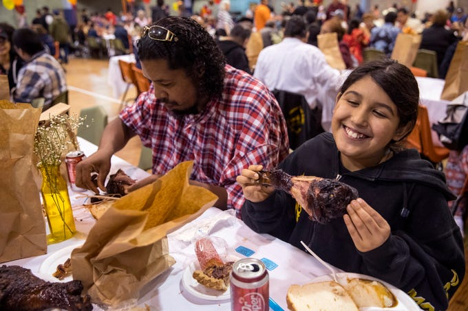 Mark Edwards (left) and his daughter, Jaylynn Escamilla, 10, enjoy a Thanksgiving meal during the 75th annual Joe Salem Dinner at Sokol Gym on Thanksgiving on Thursday, November 22, 2018.