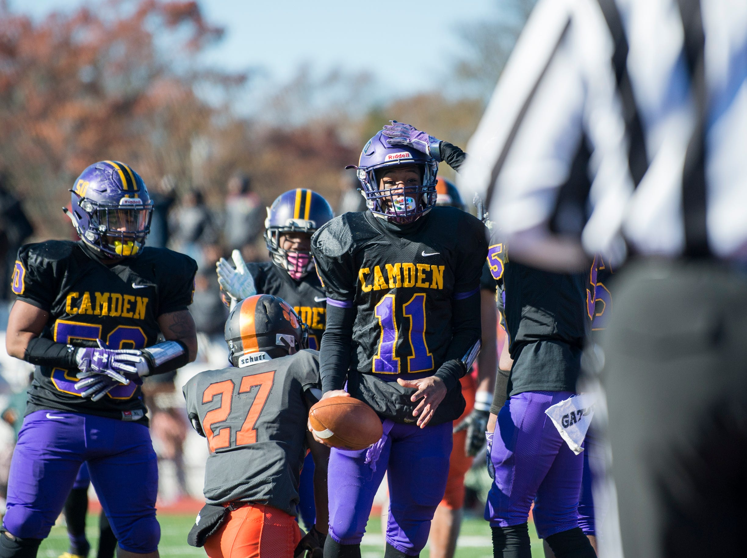 Camden's Monte Williams (11) is patted on the head after scoring a touchdown during an annual Camden-Woodrow Wilson Thanksgiving game Thursday, Nov. 22, 2018 in Camden, N.J. Camden won 39-28.