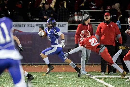 West's Johnny Ioannucci (2) takes off for a touchdown during an annual East-West game Wednesday, Nov. 21, 2018 at Cherry Hill West High School in Cherry Hill, N.J. West won 22-7.