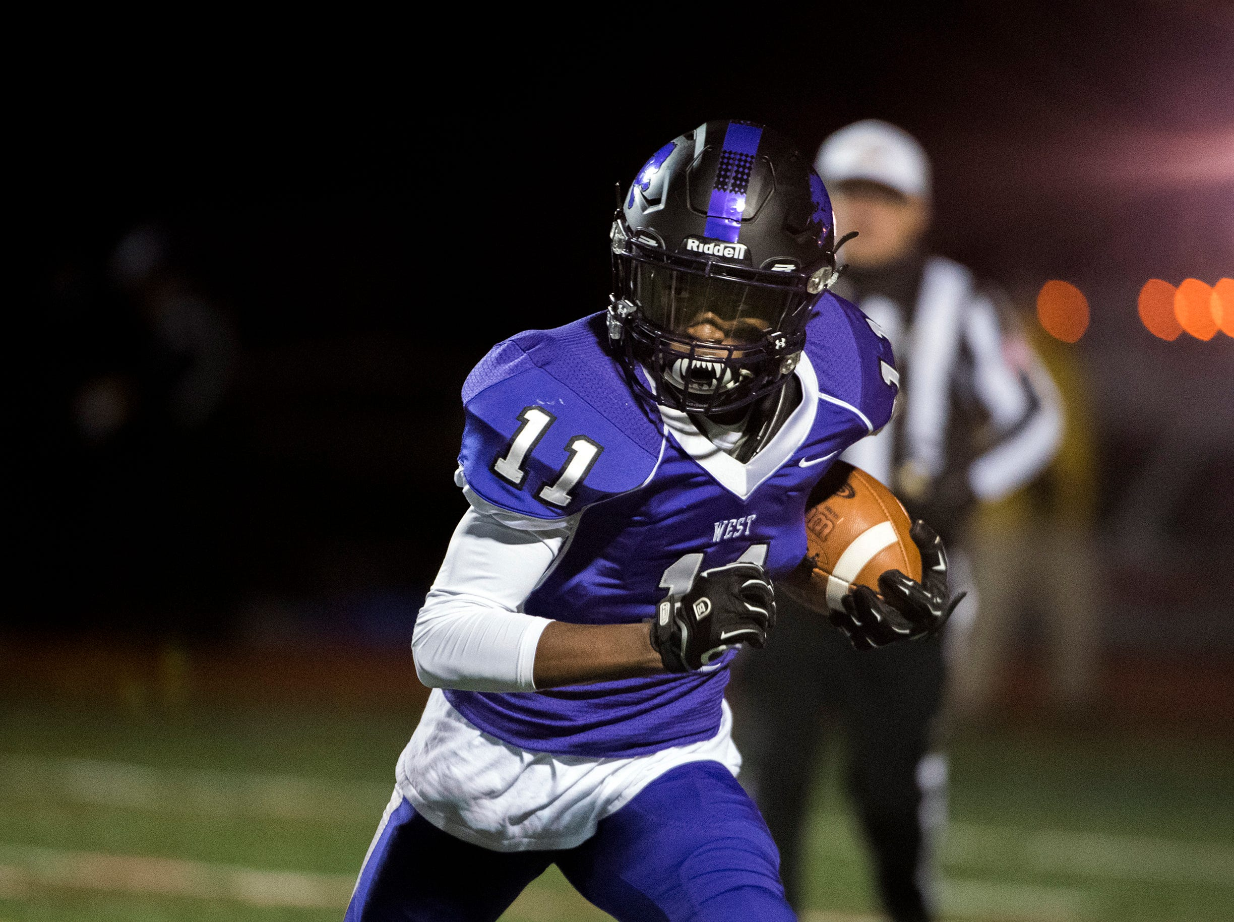 West's Hakim Melvin (11) receives the opening kickoff against East Wednesday, Nov. 21, 2018 at Cherry Hill West High School in Cherry Hill, N.J.