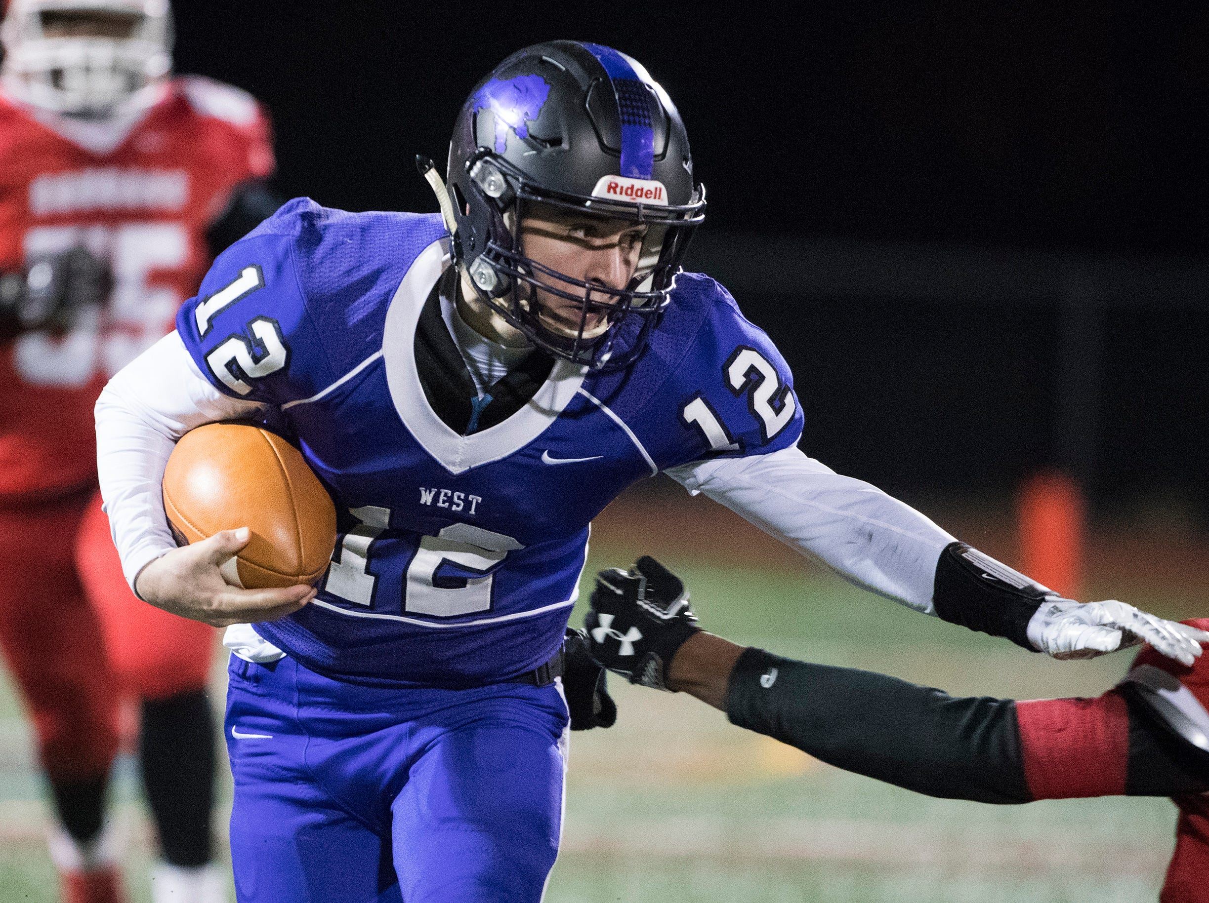 West's Nick Arcaroli (12) carries the ball during an annual East-West game Wednesday, Nov. 21, 2018 at Cherry Hill West High School in Cherry Hill, N.J. West won 22-7.