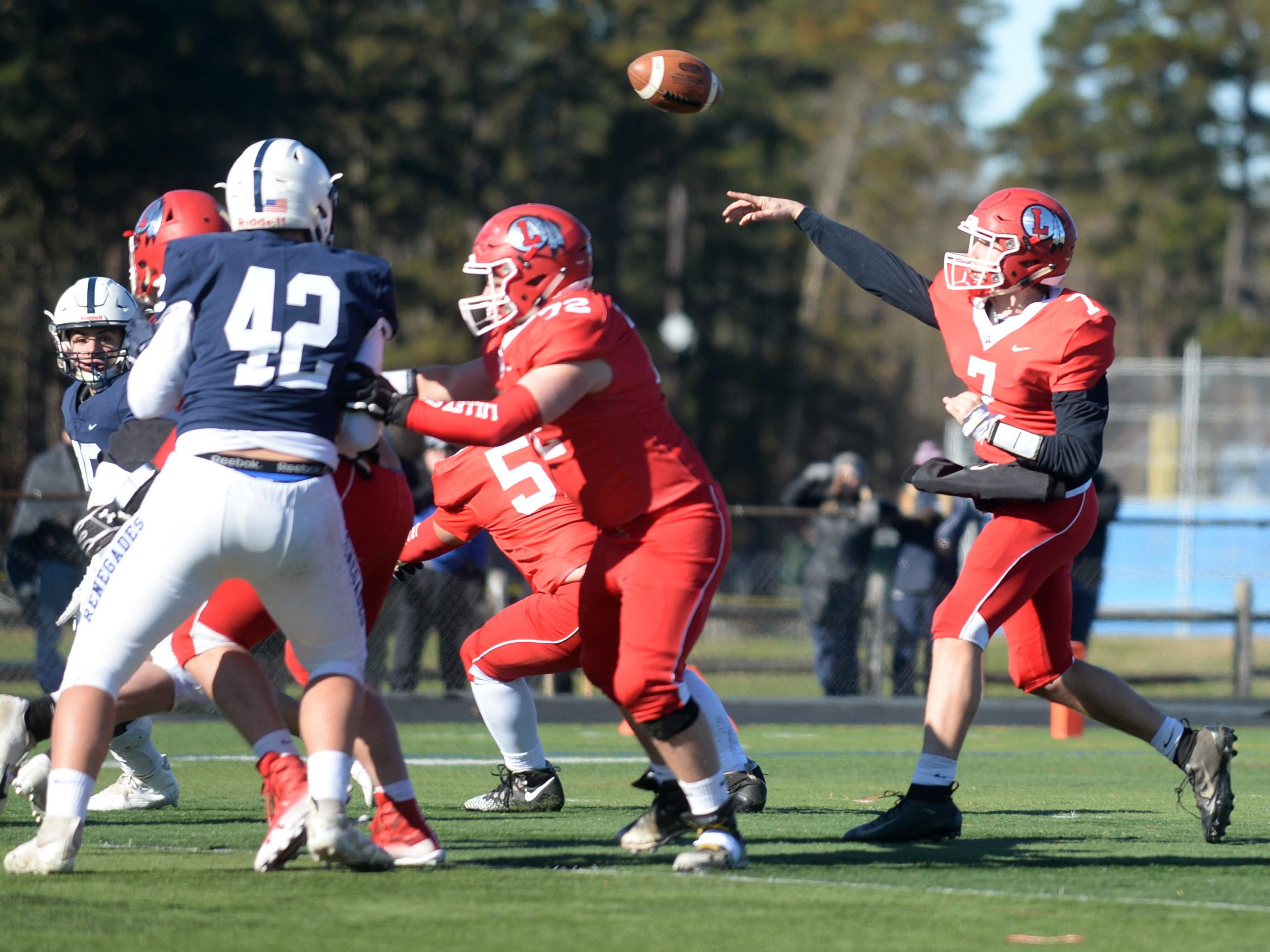 Lenape's Brady Long throws a pass during the Thanksgiving Day football game against Shawnee at Shawnee High School, Thursday, Nov. 22, 2018.