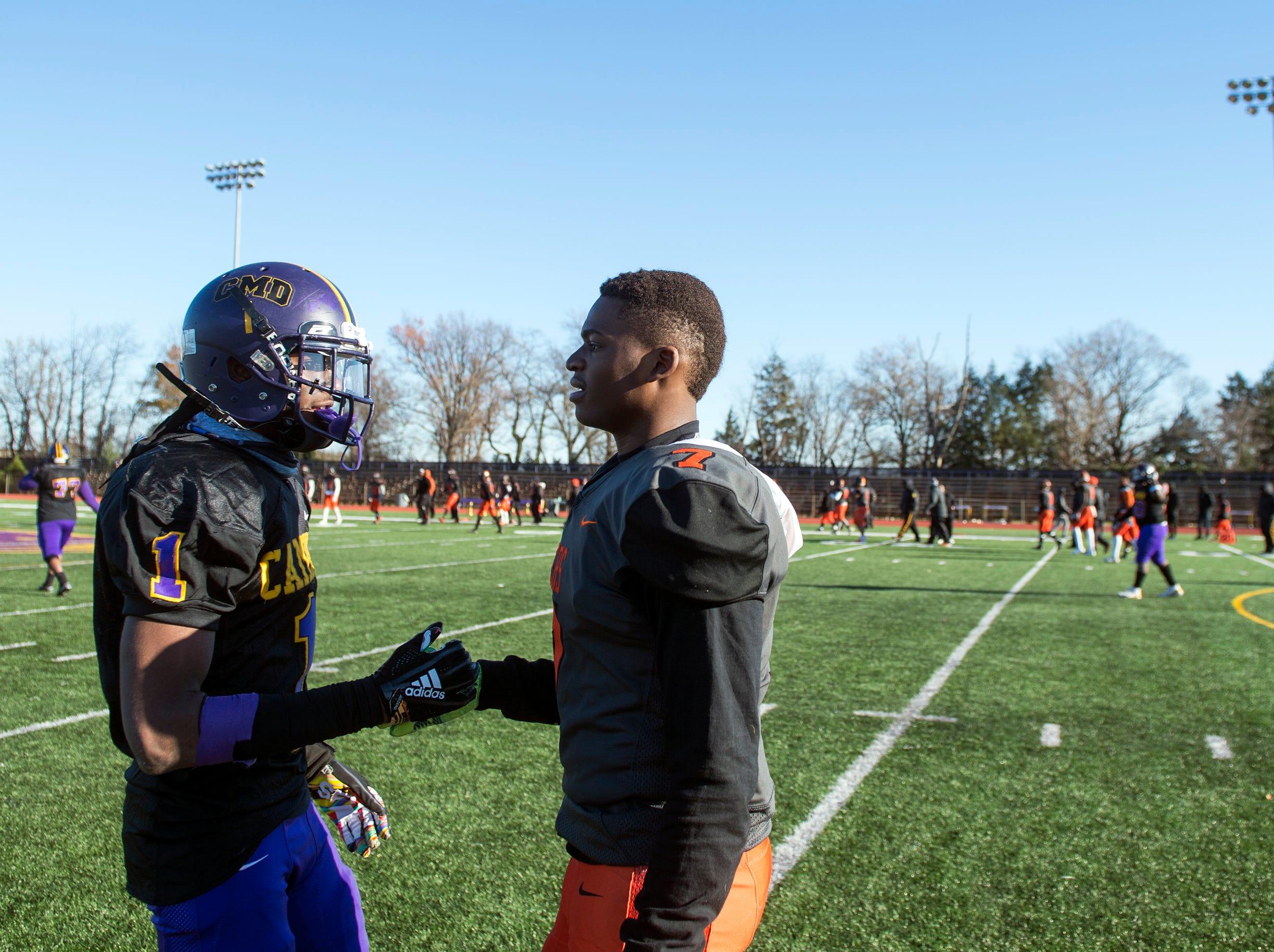 Camden's Corey Palmer (1) and Woodrow Wilson's Malik Harvey (7) shake hands following an annual Camden-Woodrow Wilson Thanksgiving game Thursday, Nov. 22, 2018 in Camden, N.J. Camden won 39-28.