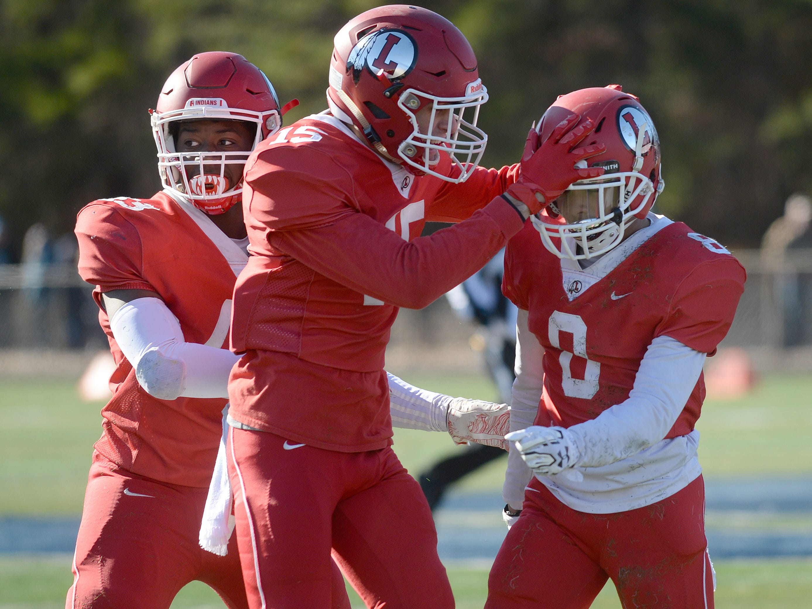 Lenape's Amir Byrd celebrates with his teammates after intercepting a Shawnee pass during the Thanksgiving Day football game at Shawnee High School, Thursday, Nov. 22, 2018.
