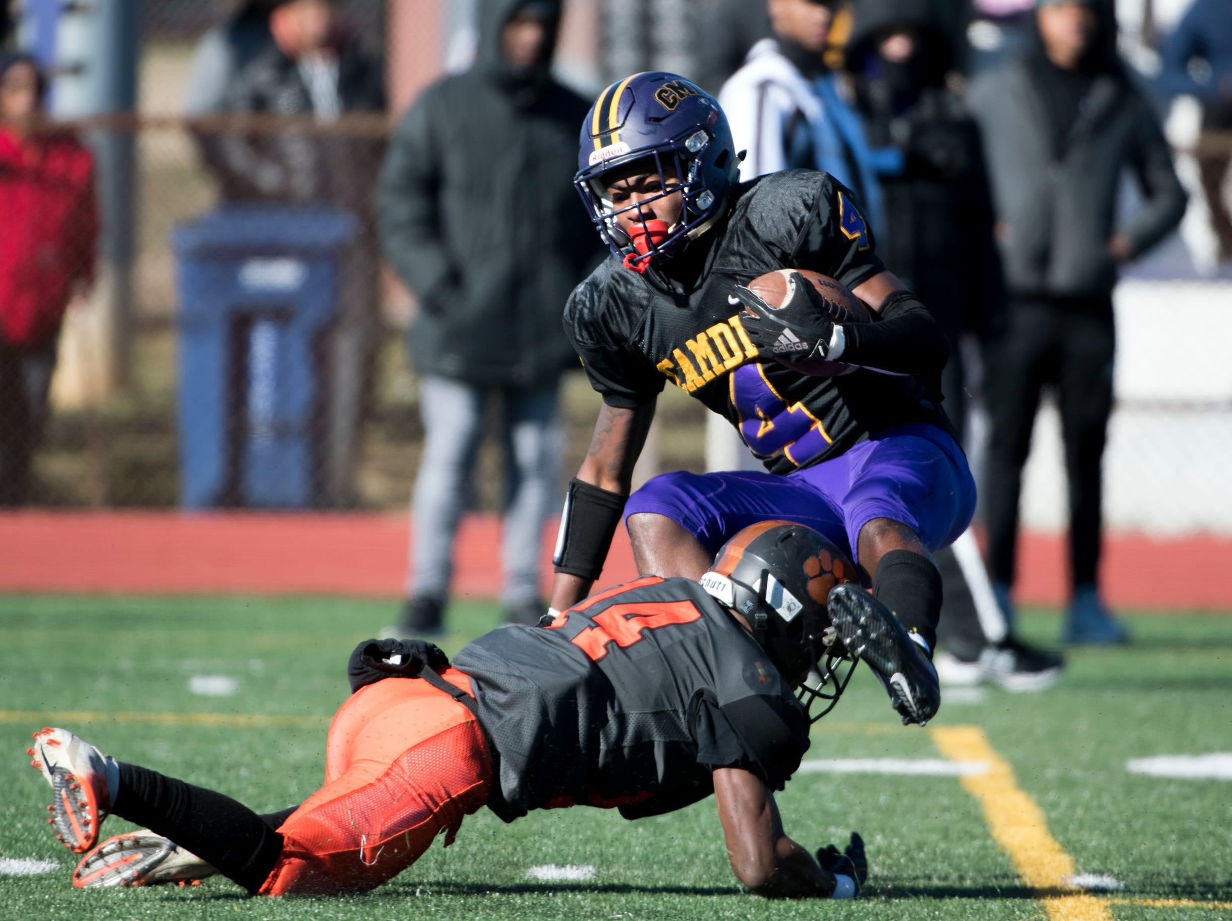 Camden's Jajuan Hudson (4) is tackled during an annual Camden-Woodrow Wilson Thanksgiving game Thursday, Nov. 22, 2018 in Camden, N.J. Camden won 39-28.
