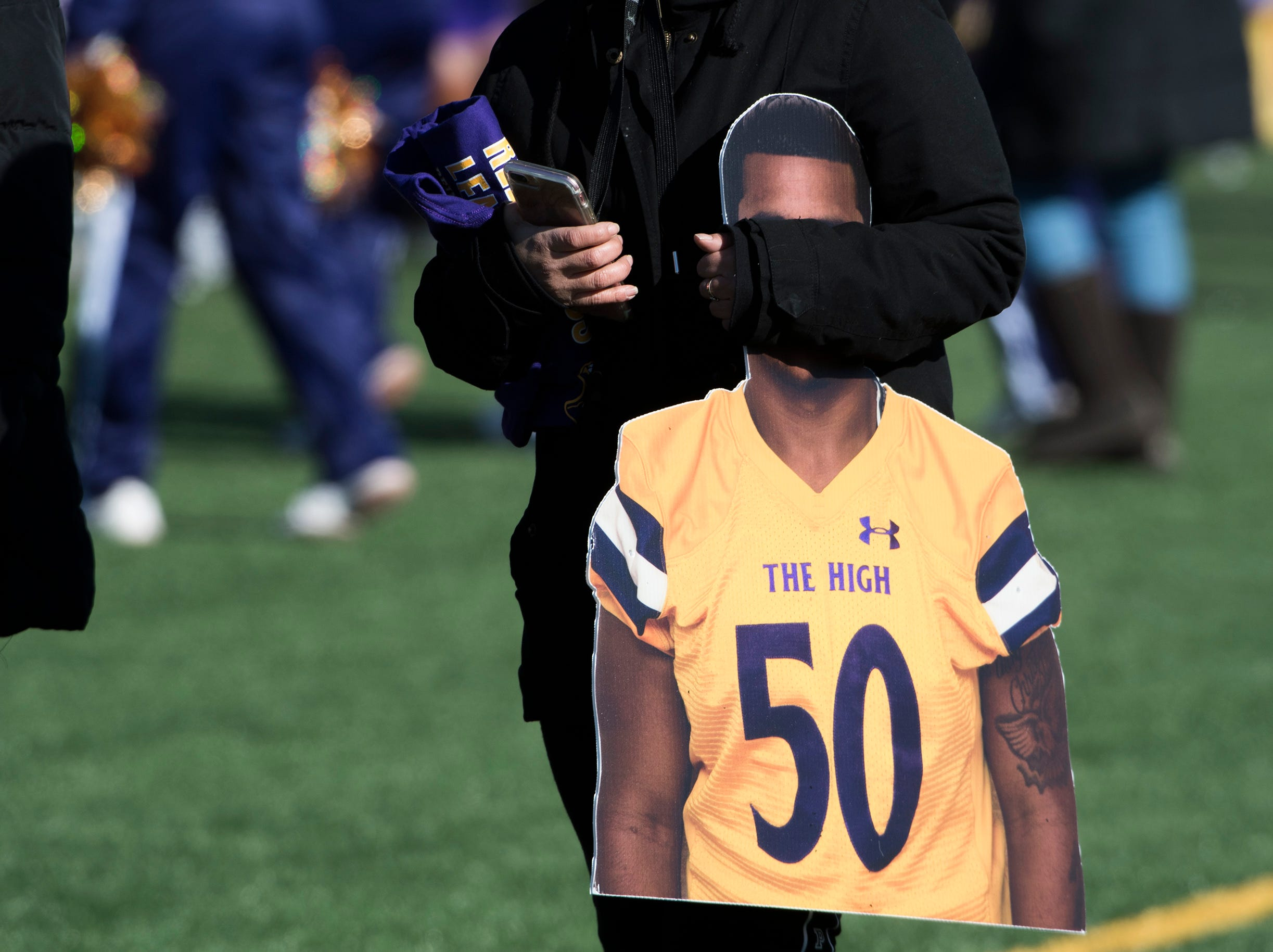 A cardboard cutout of Camden's Hiram Castro is carried on the sideline before an annual Camden-Woodrow Wilson Thanksgiving game Thursday, Nov. 22, 2018 in Camden, N.J. Camden won 39-28.