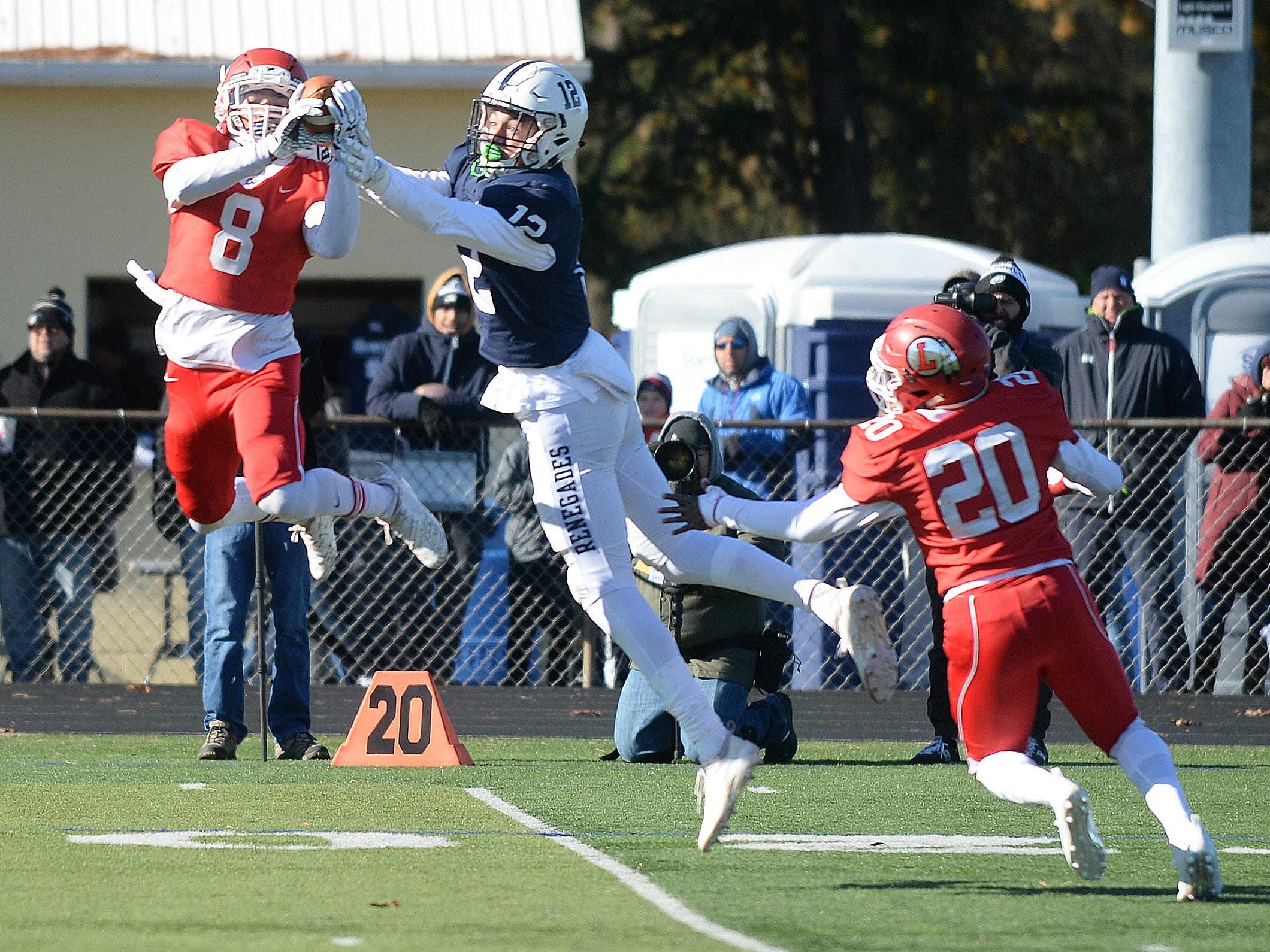 Lenape's Amir Byrd intercepts a pass intended for Shawnee's Nate Summerville during the Thanksgiving Day football game at Shawnee High School, Thursday, Nov. 22, 2018.