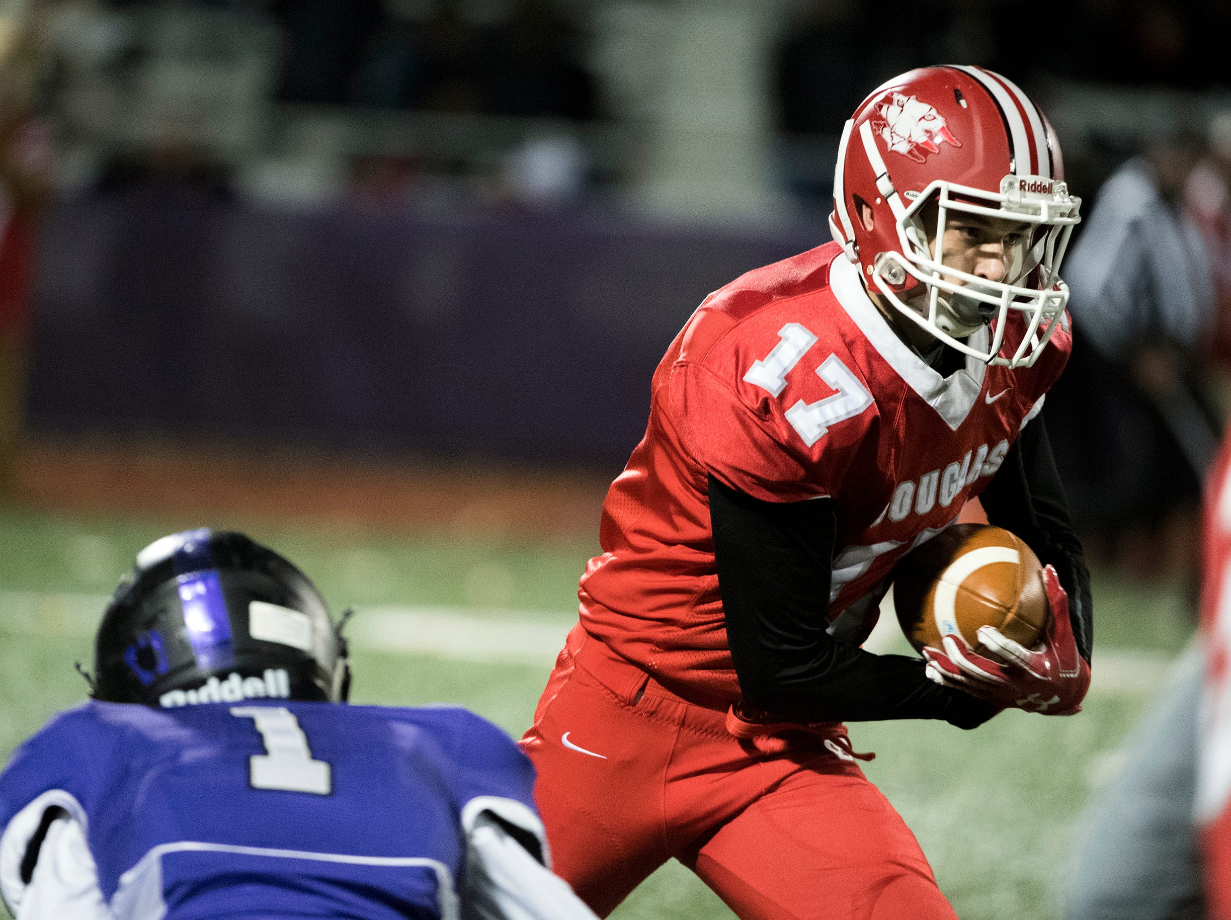 East's Sean Welsh (17) carries the ball during an annual East-West game Wednesday, Nov. 21, 2018 at Cherry Hill West High School in Cherry Hill, N.J. West won 22-7.