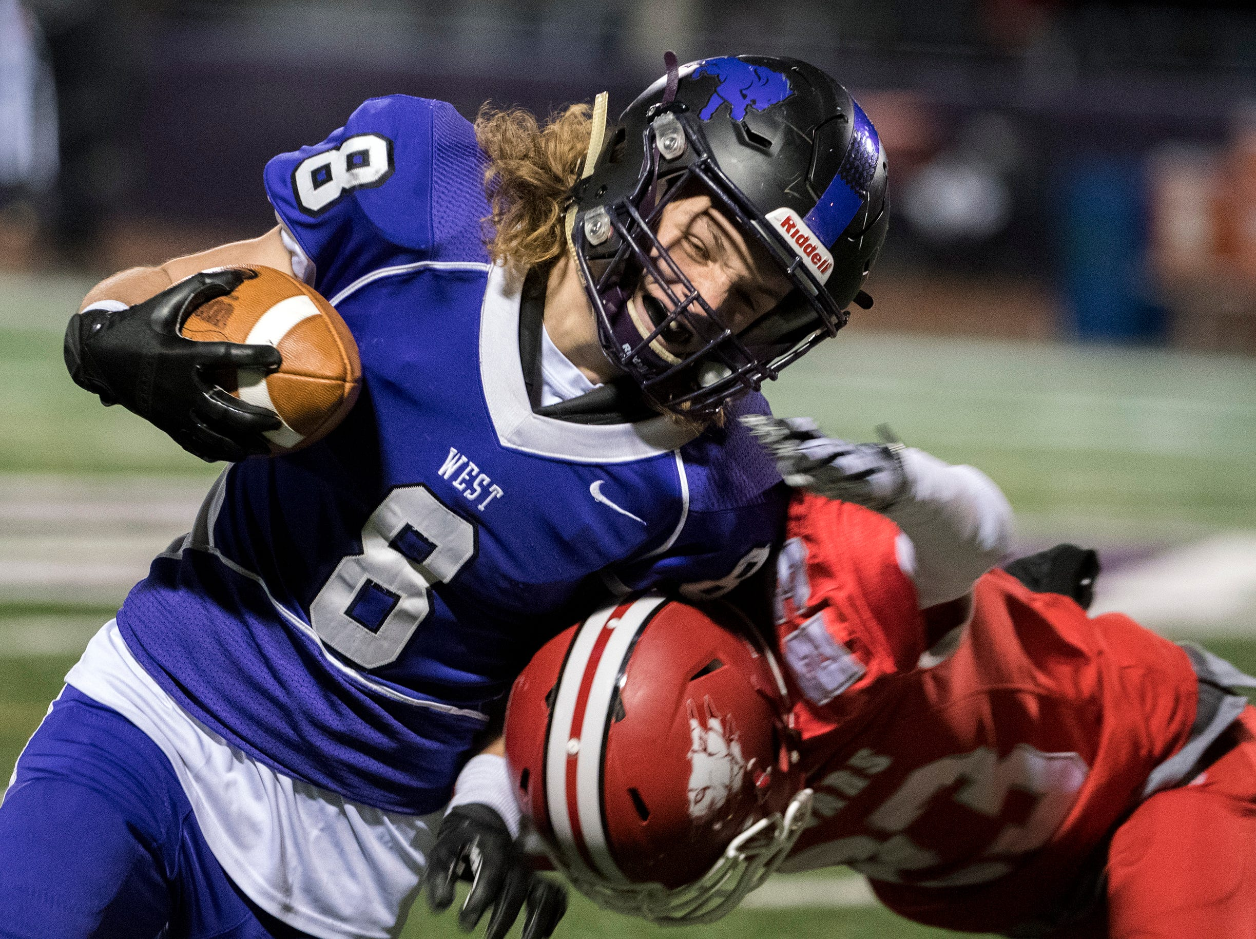 West's Nick Jester (8) carries the ball against East Wednesday, Nov. 21, 2018 at Cherry Hill West High School in Cherry Hill, N.J.