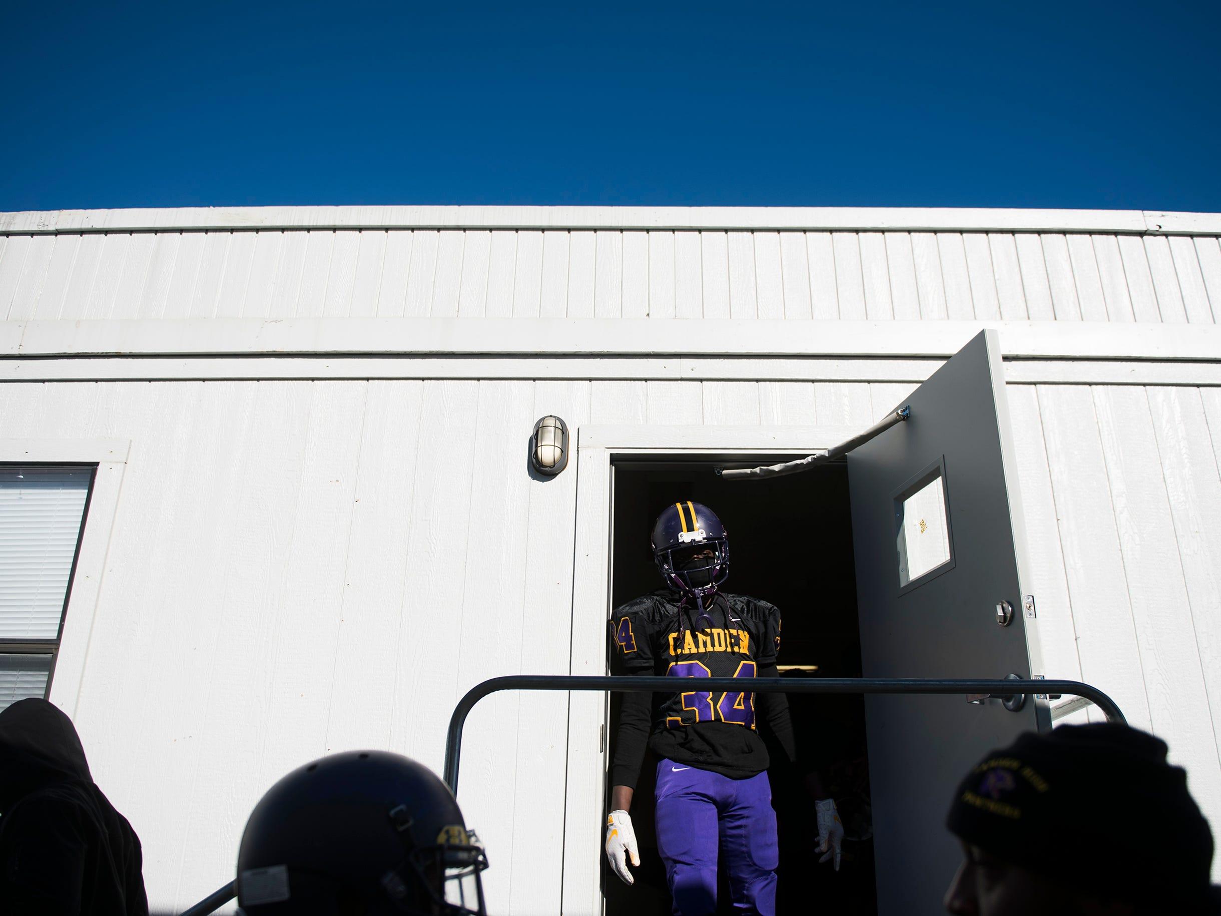 Camden's Zyeer Blount (34) exits the locker room to begin the second half during an annual Camden-Woodrow Wilson Thanksgiving game Thursday, Nov. 22, 2018 in Camden, N.J. Camden won 39-28.