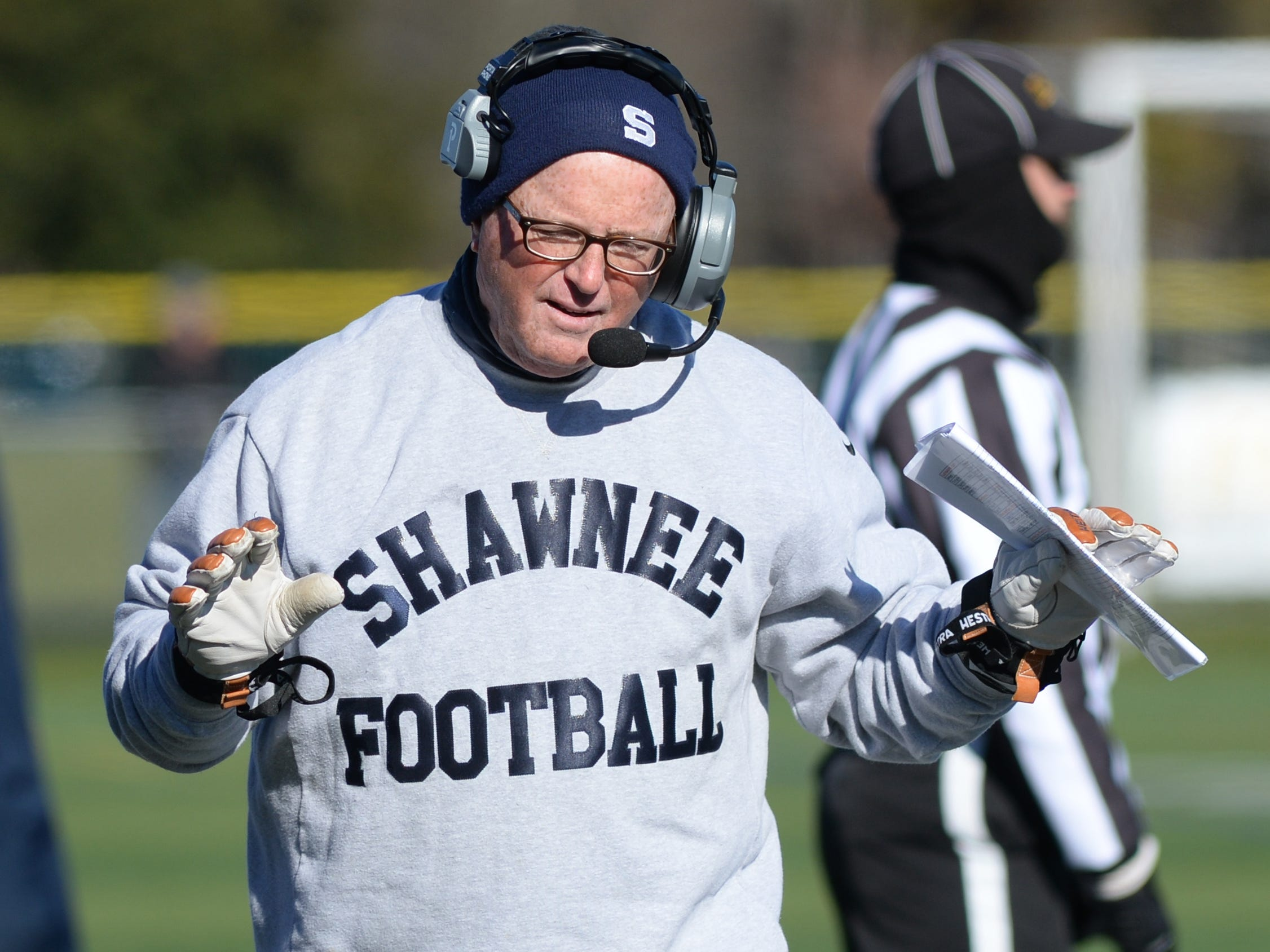 Shawnee's coach Tim Gushue talks with his coaching staff during the Thanksgiving Day football game against Lenape at Shawnee High School, Thursday, Nov. 22, 2018.